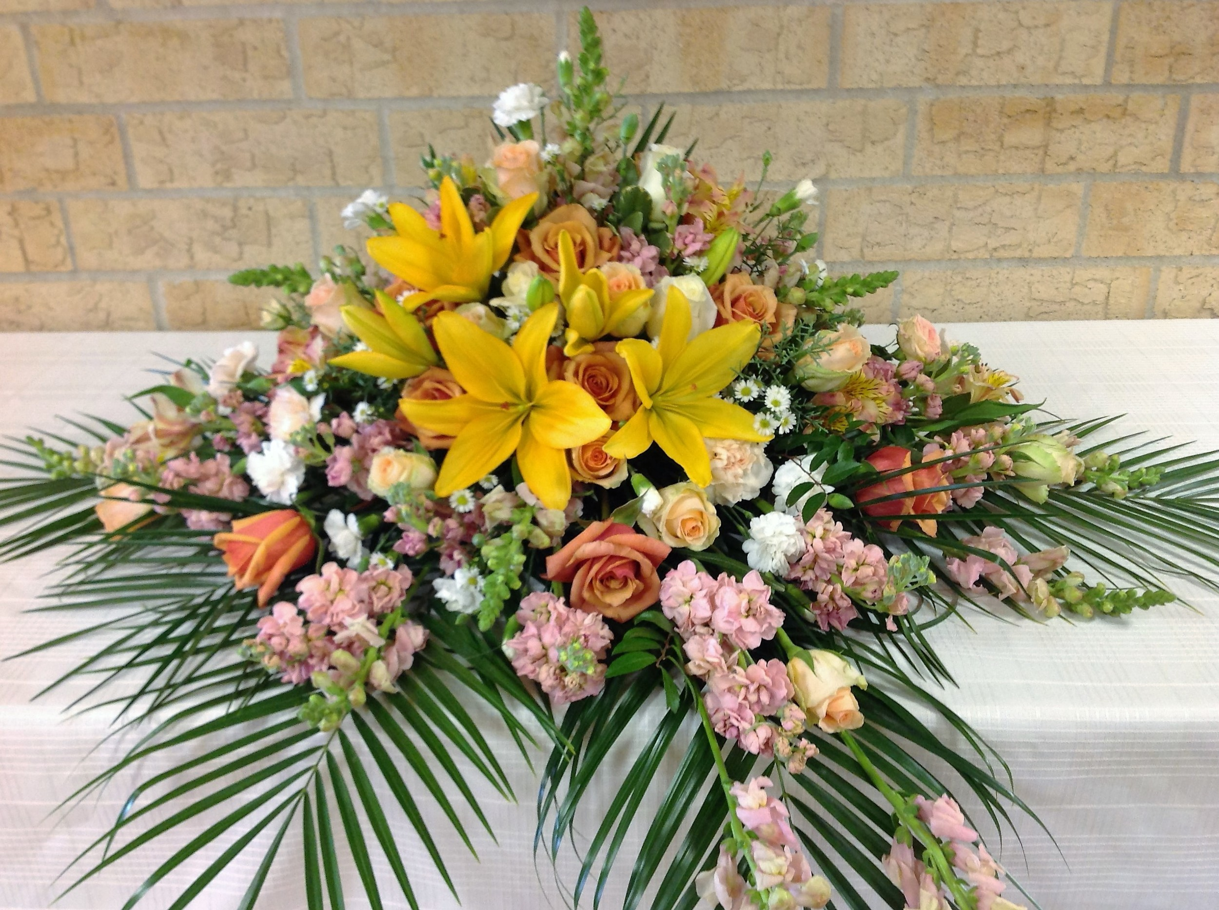 #6 multi colored bright lily casket spray