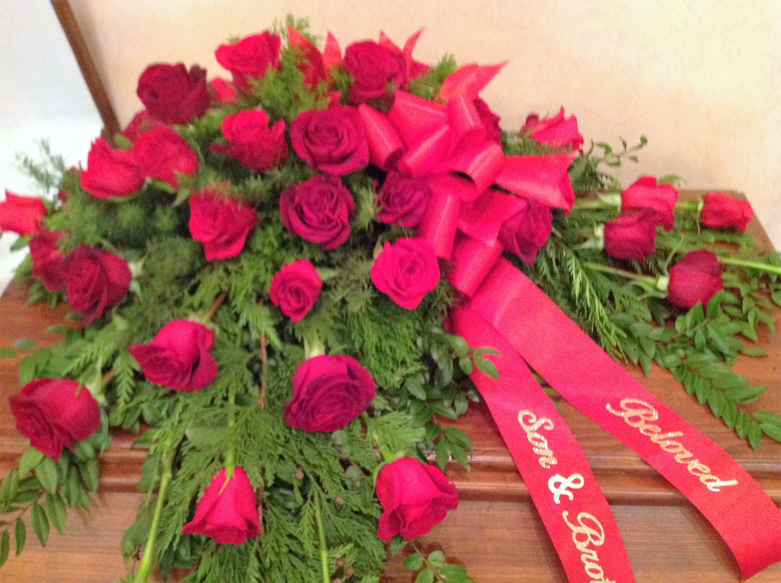 #3 Red roses, evergreens casket spray
