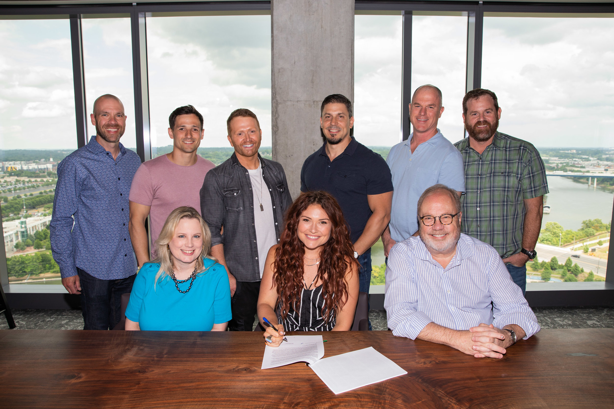 Pictured (L-R, front row): UMG Nashville President Cindy Mabe, Kylie Morgan, UMG Nashville Chairman & CEO Mike Dungan; (L-R, back row): Dickson Wright's Austen Adams, SMACKSongs Senior Vice President Project Development Robert Carlton, SMACKSongs Owner Shane McAnally, UMG Nashville Senior Vice President Business and Legal Affairs Rob Femia, UMG Nashville COO Mike Harris, UMG Nashville Executive Vice President Promotion Royce Risser. Photo: Katie Kauss