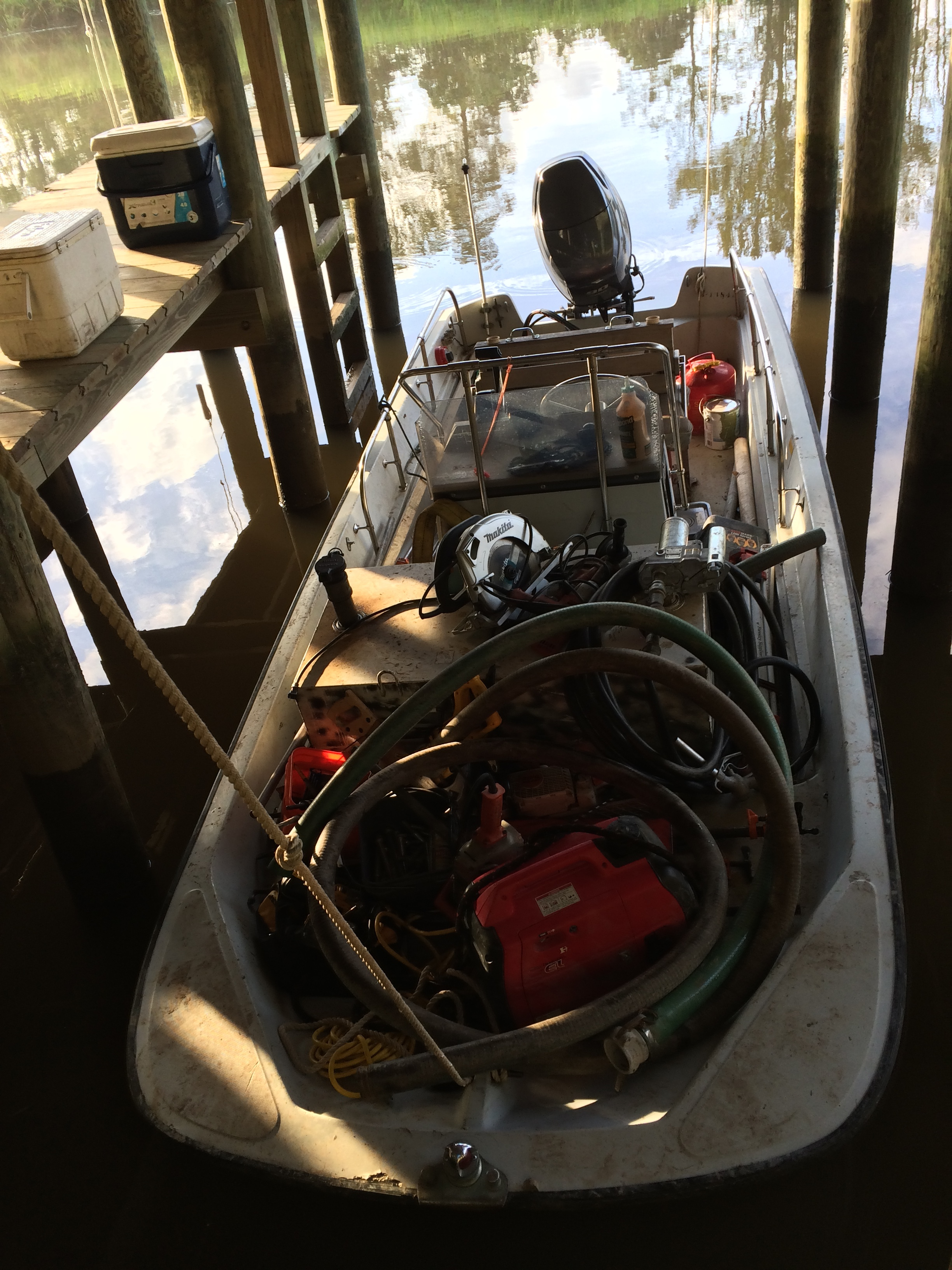Skiff loaded with tools and ready to head out to the impoundment in the boathouse at Samworth