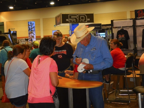 """Forrest L. Wood, considered by many to be the """"father of the modern bass boat"""" signs autographs during the Expo for the bass fishing tournament that bears his name; August 2017 in Columbia. SCDNR photo by David Lucas"""