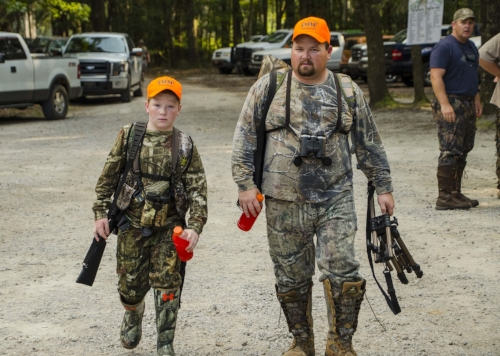 """Time to get serious -- Jacob """"P-Nut"""" New and his Dad, Leroy, get ready to get down to business.   SCDNR photo by David Lucas"""