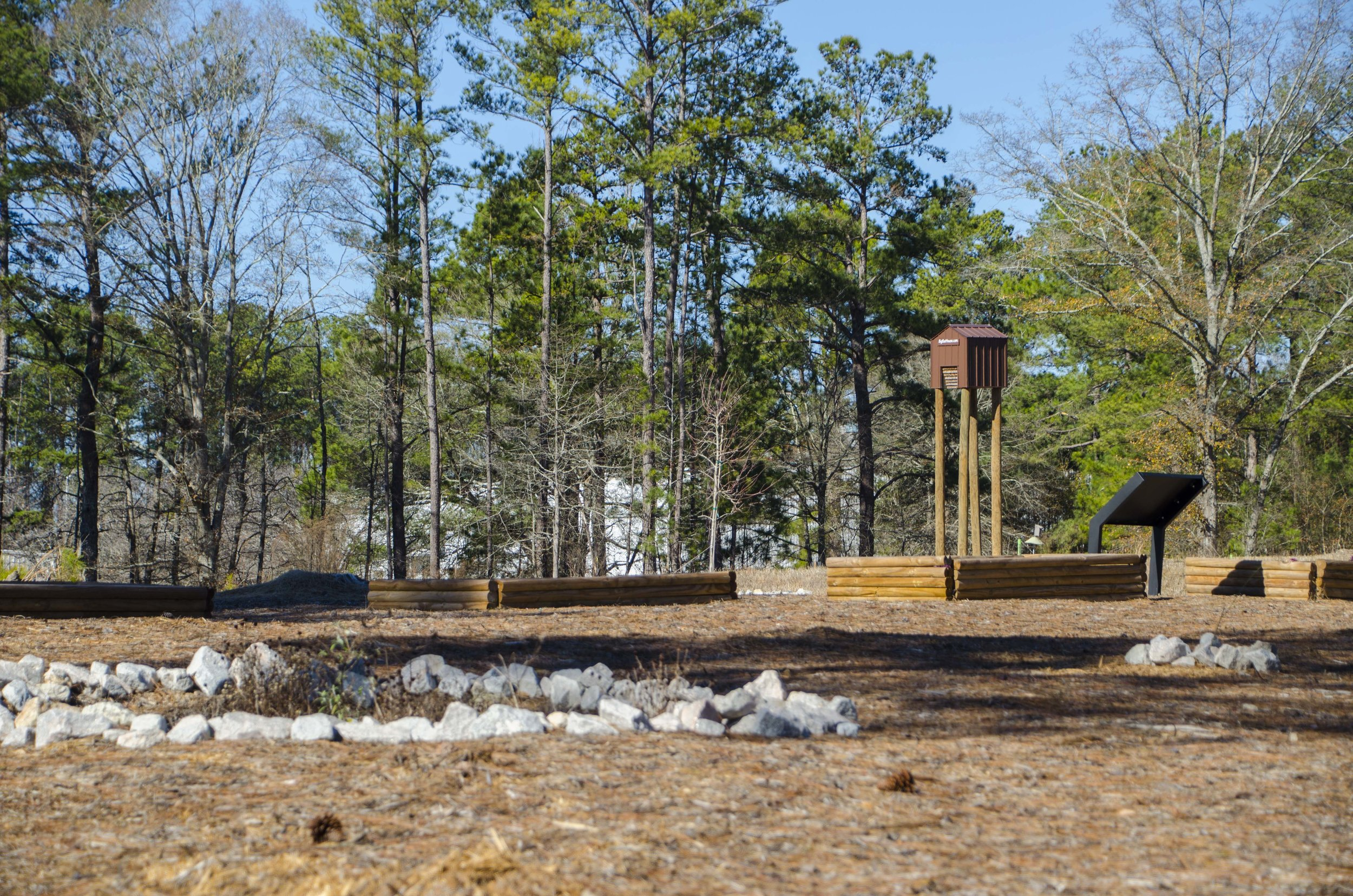 Walking trails at the NWTF headquarters (that's a bat house in the distance).(SCDNR photo by D. Lucas)