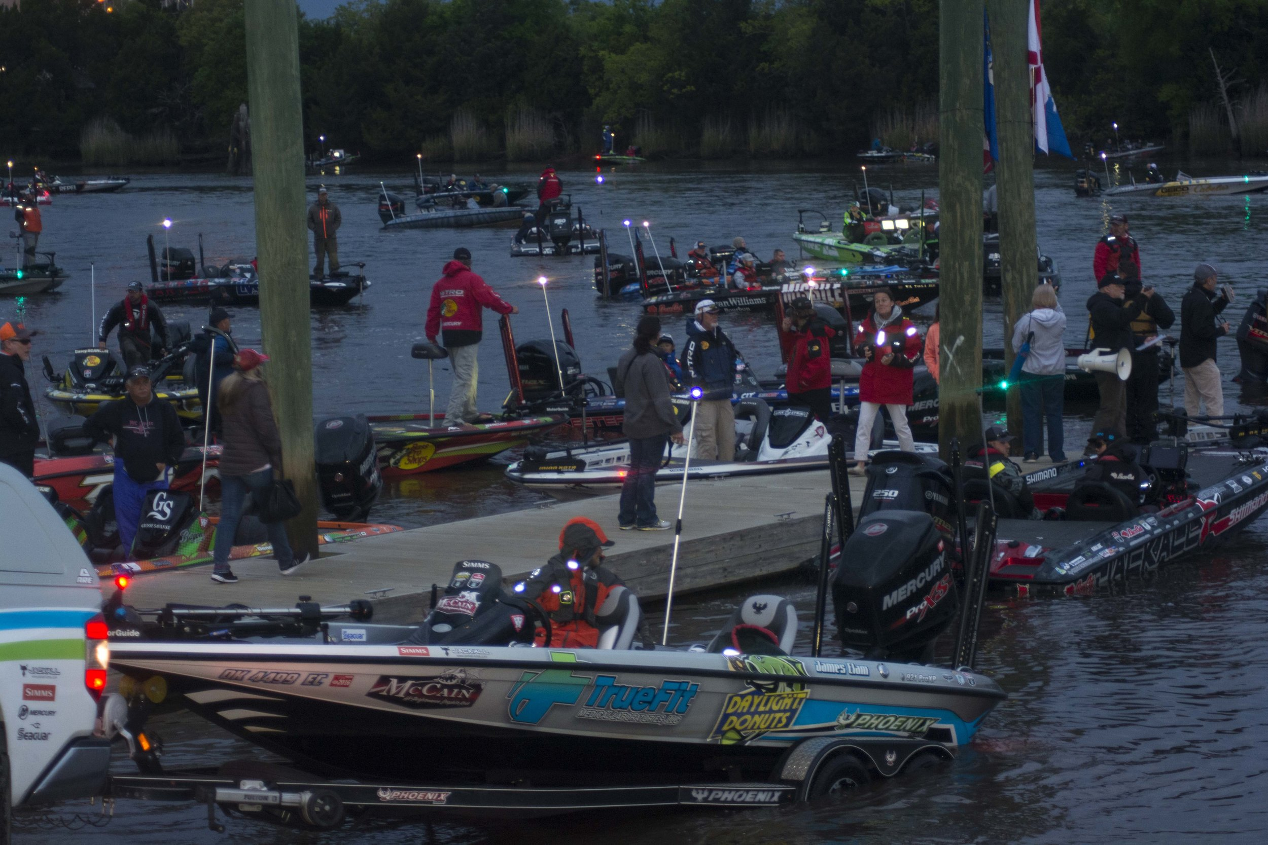 The scene at the early-morning takeoff for a big-time professional bass fishing tournament can resemble controlled chaos, but it's all designed to get the competitors on the water in an organized way and build excitement for the spectators -- part rock concert, part photo-op,  and all fun! [SCDNR photo by David Lucas]