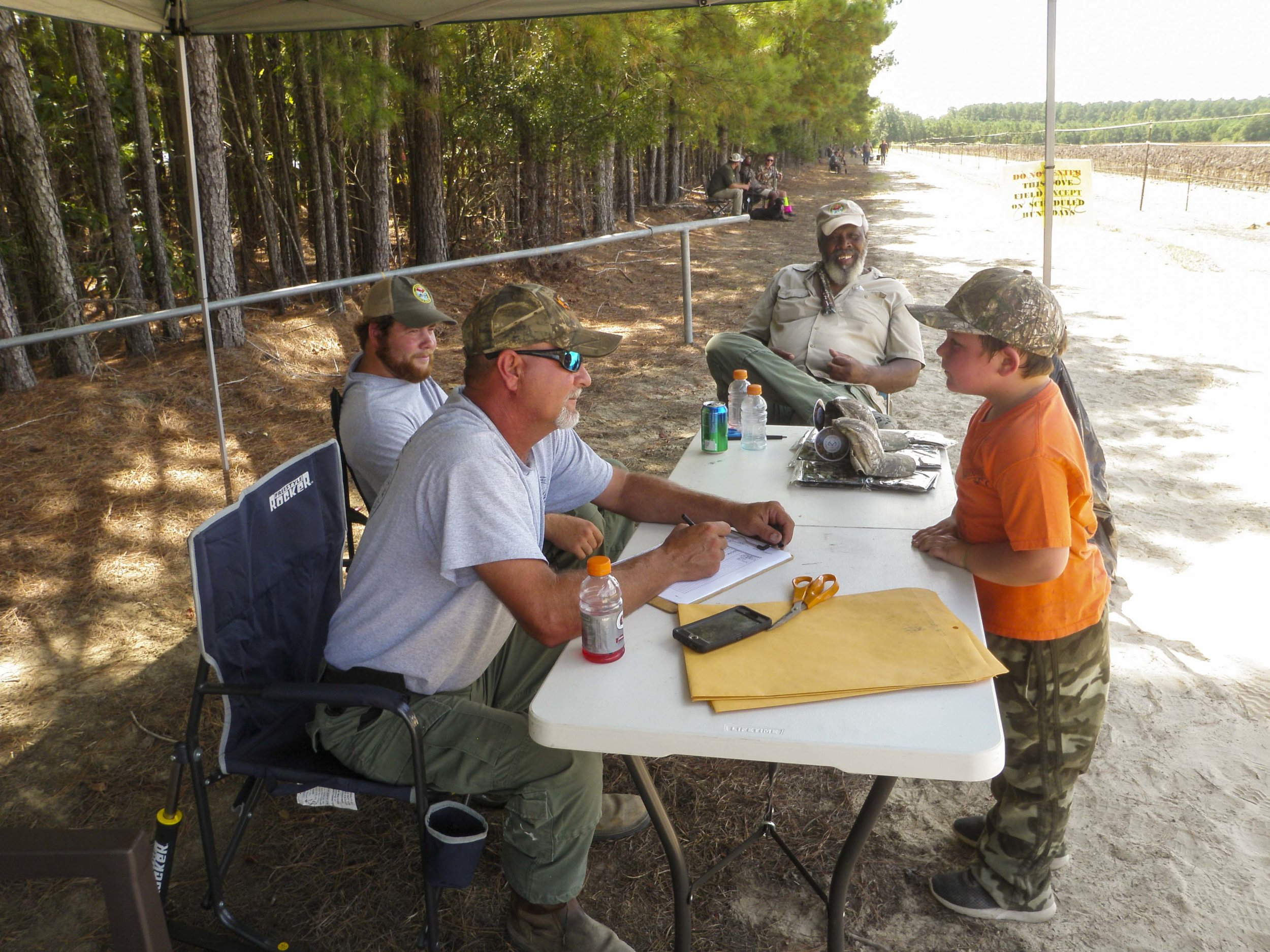 SCDNR wildlife technicians collect data from a young hunter at Pee Dee Station dove field.