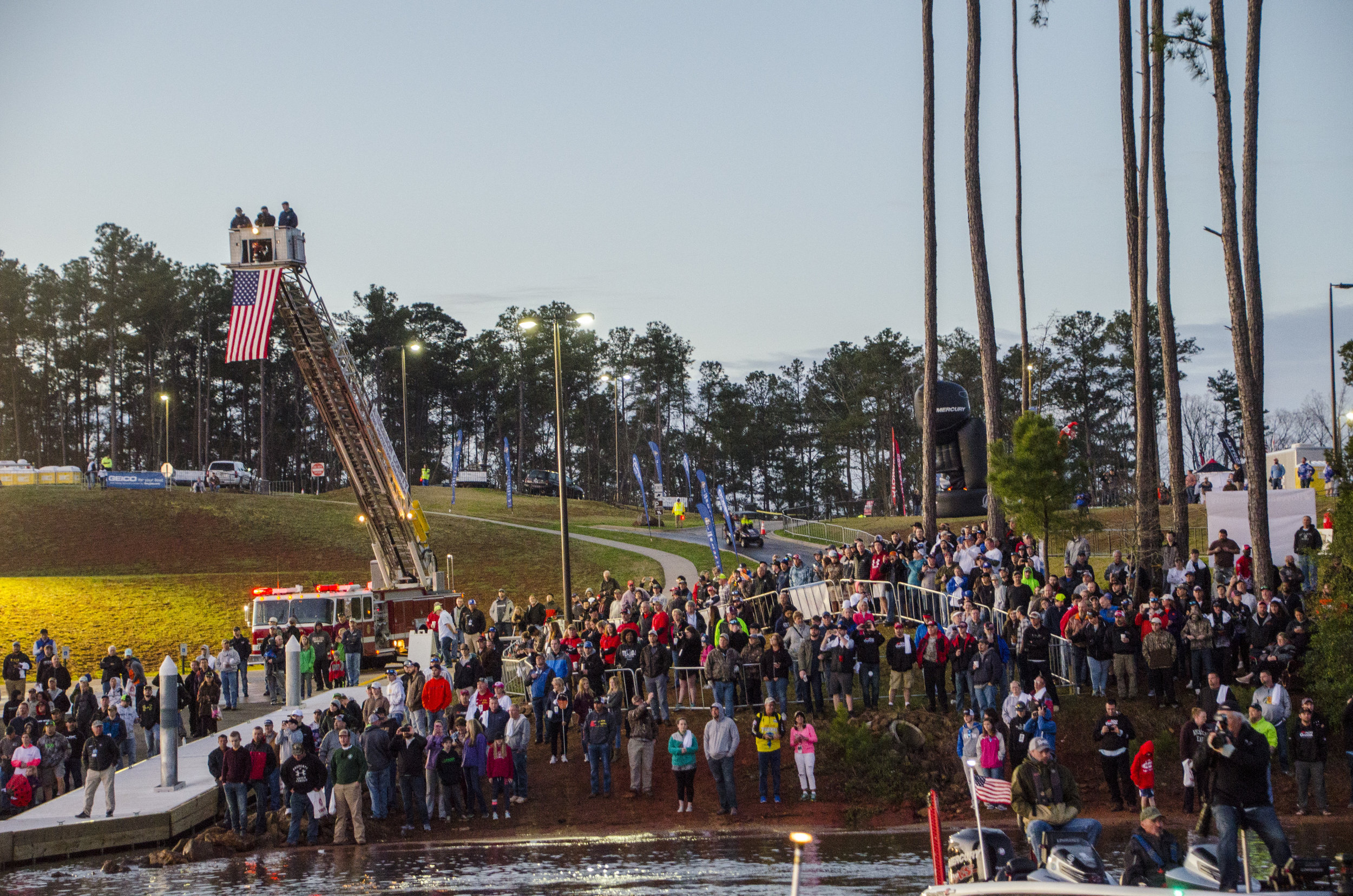 Excited fans crowd the shoreline for the first day of fishing at the 2018 Bassmaster Classic at Lake Hartwell's Green Pond Landing.