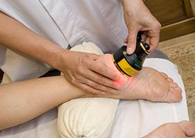 Injured foot receiving focused treatment