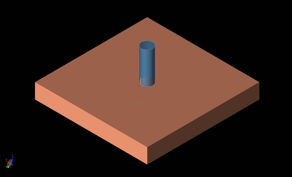 Figure 1:  A three-dimensional CAD representation of the geometry is shown with a conducting ground plane under a cylindrical dielectric resonator with permittivity of 7.  The resonator is excited by a coaxial probe on one side of the cylinder.
