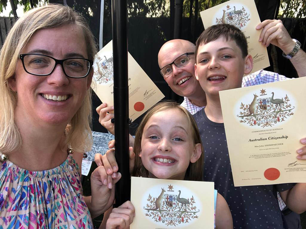 Kai Eberspaecher (MBA 2005)  and family show off their Australian citizenship certificates.