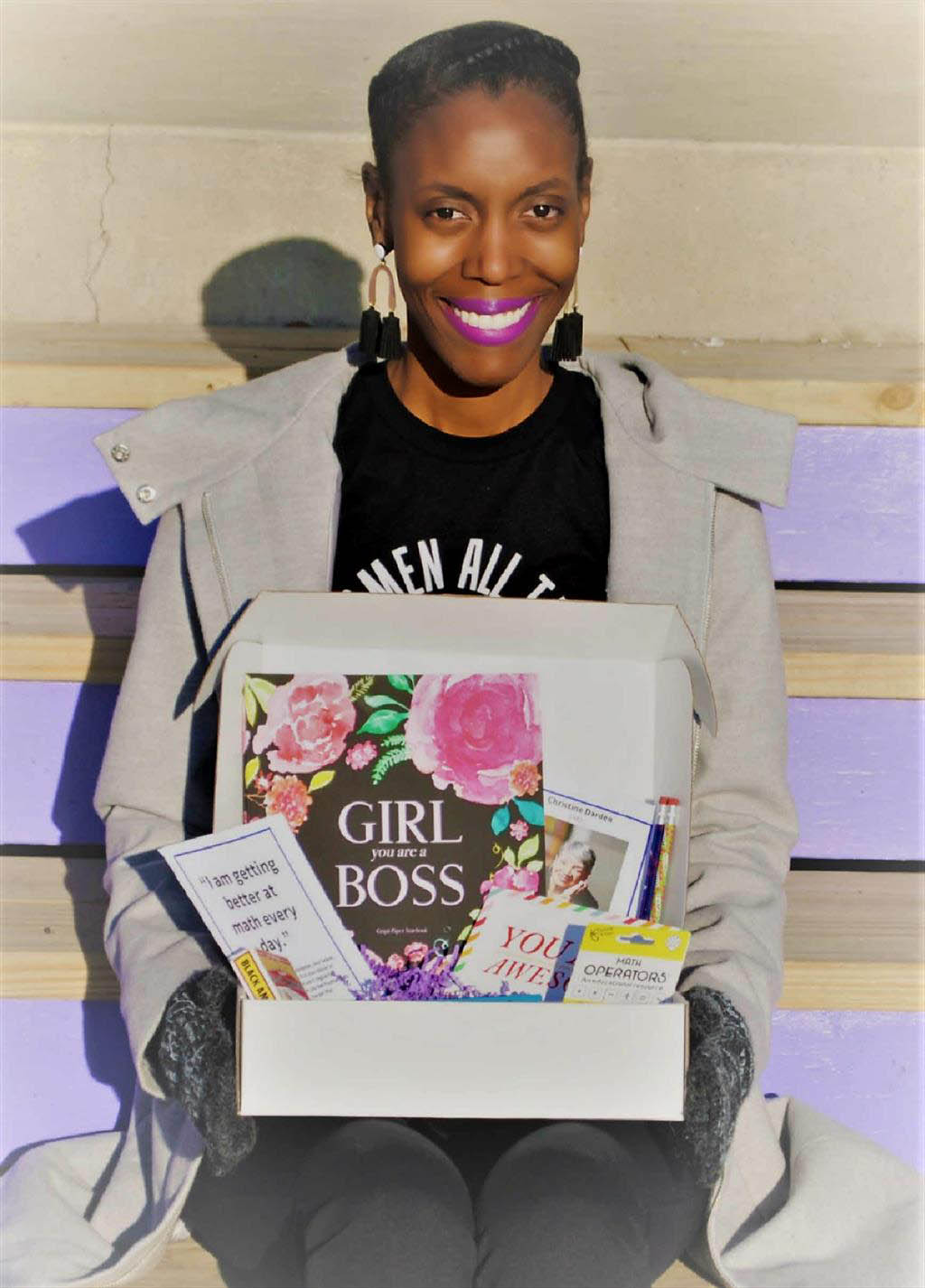 Brittany Rhodes (MBA 2010)  shows off a Black Girl MATHGIC subscription box.