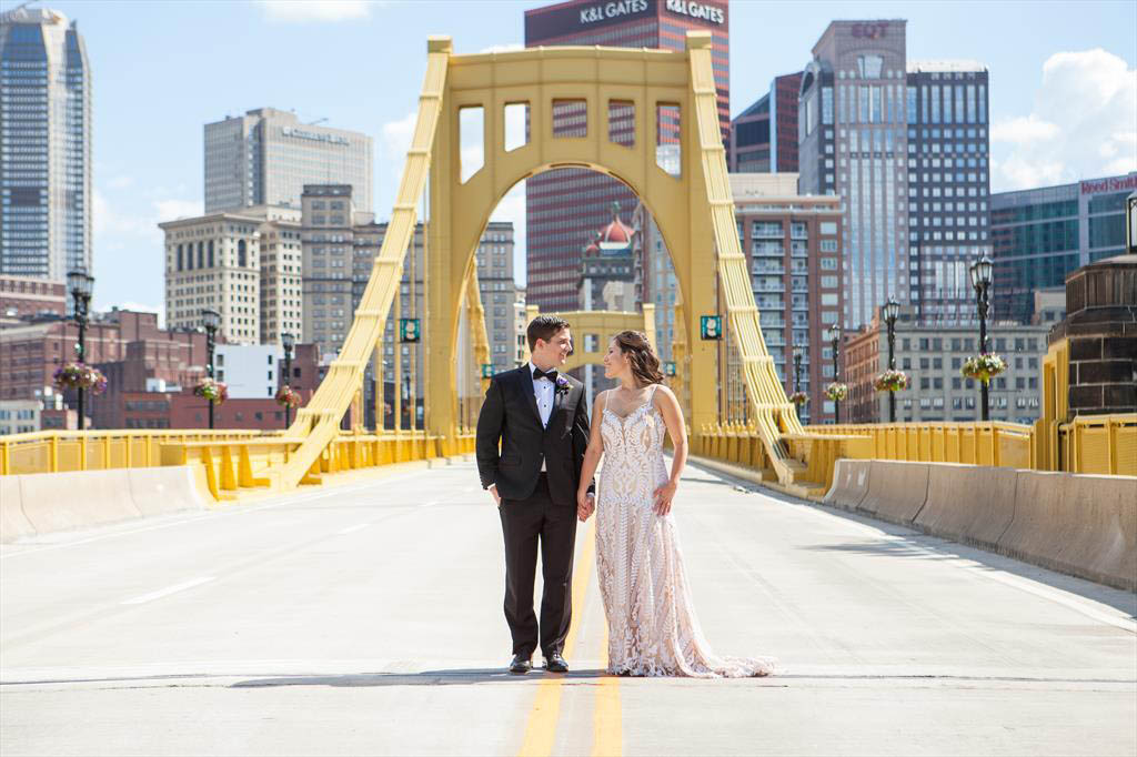 Wedding photo of  Jesse Trowbridge (MBA 2014)  and  JoAnn Trowbridge (MBA 2015)  on the Andy Warhol Bridge in Pittsburgh, Pennsylvania.