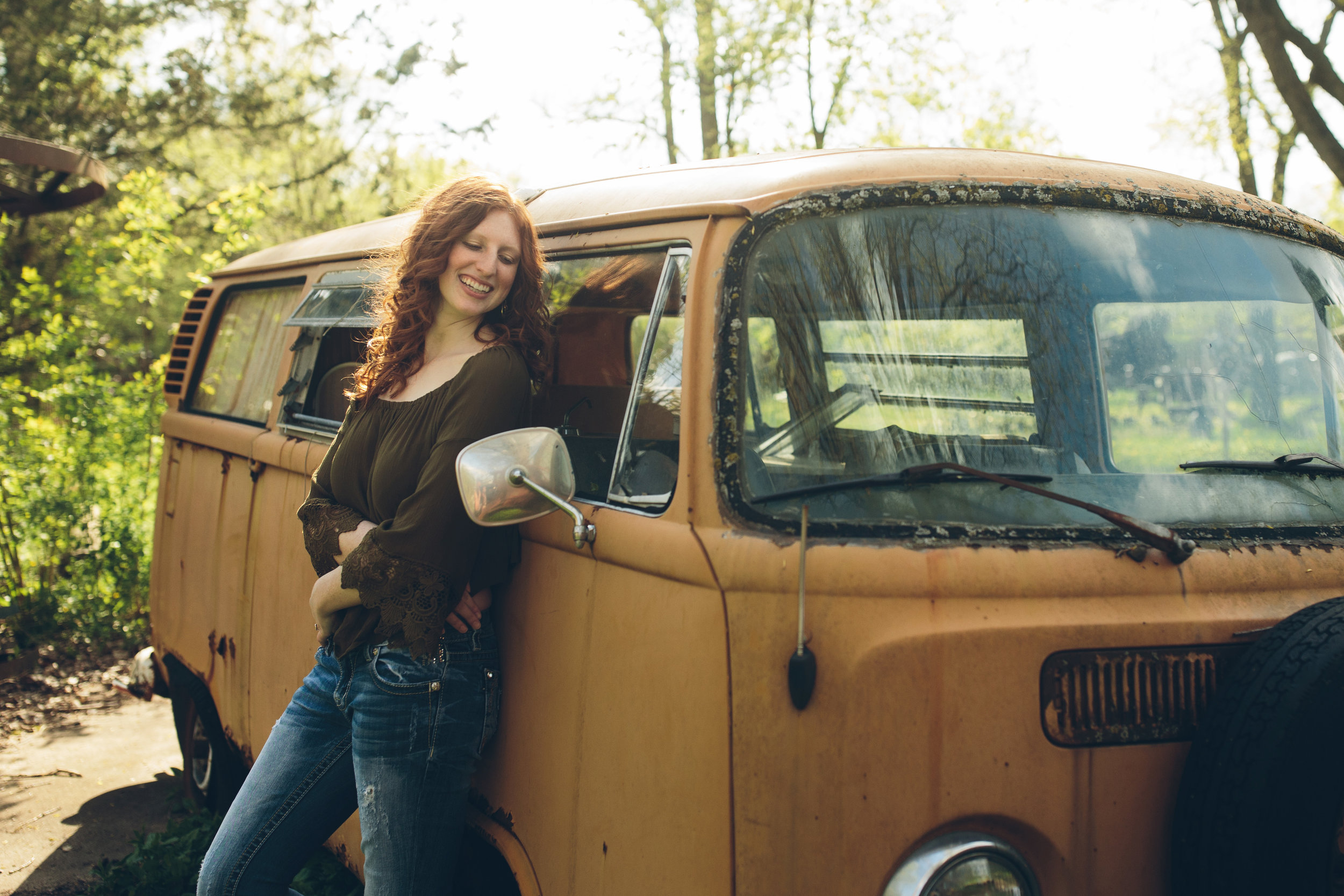 Senior photo with red head in front of VW van in Madison, WI.