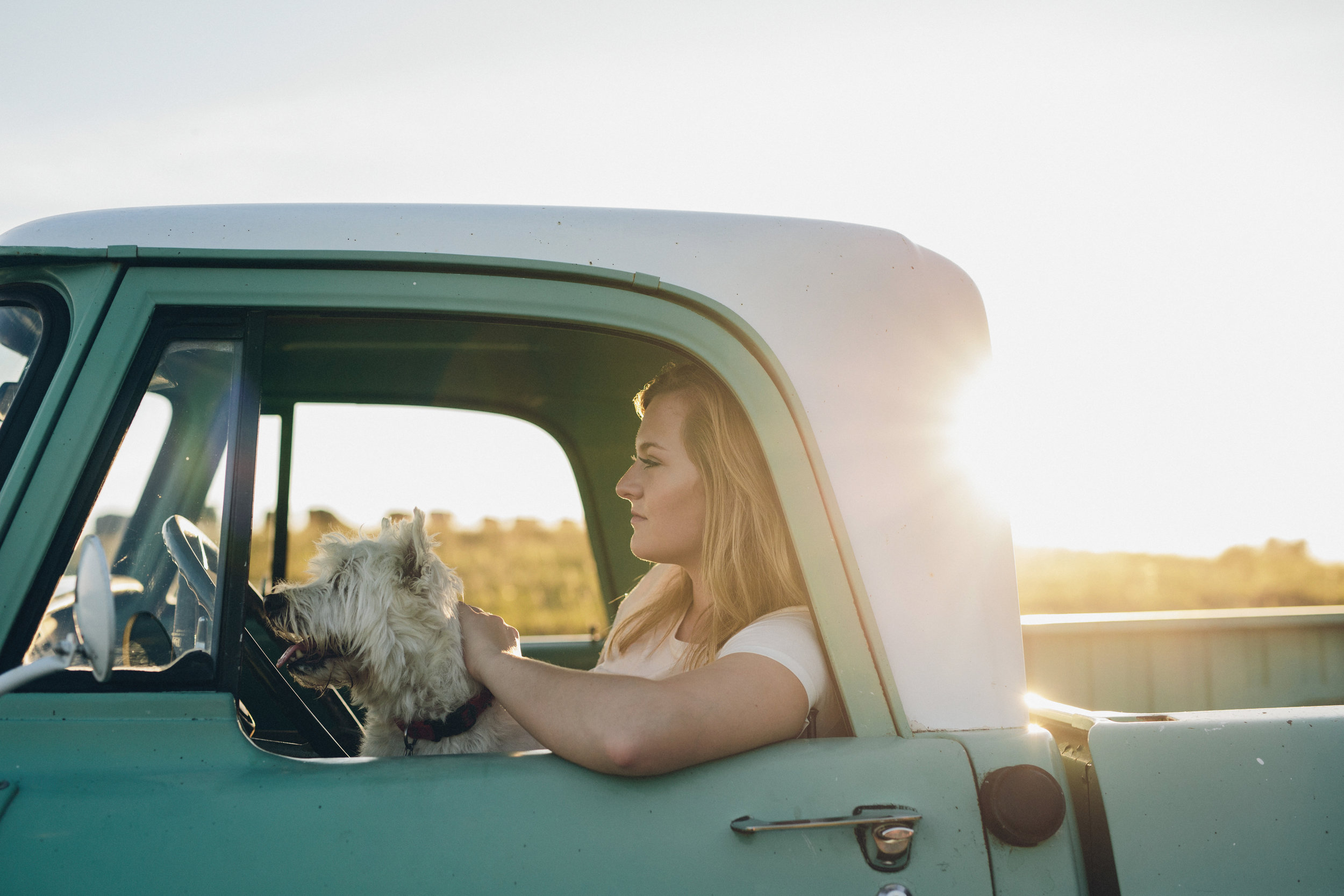 A girl and her dog in a classic truck senior photo session in Madison, WI.