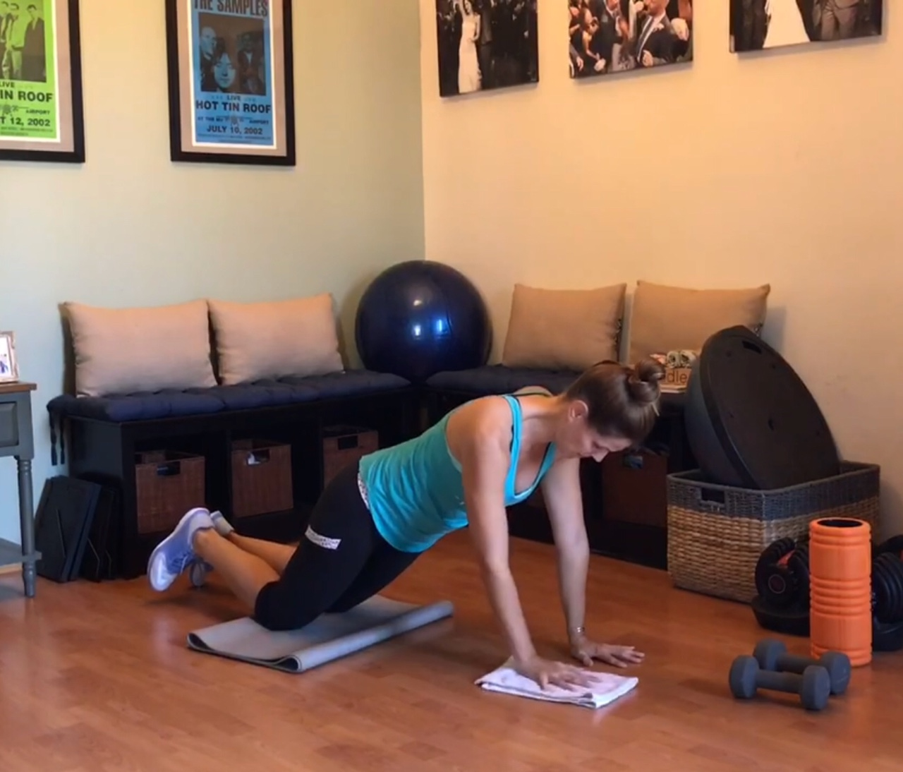 5 months pregnant getting ready to do a towel slide out pushup