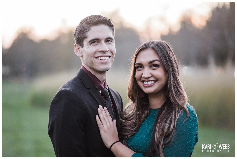 Orange County Photographer _ Kari Webb Photography _ couple smiling at sunset in grassy park