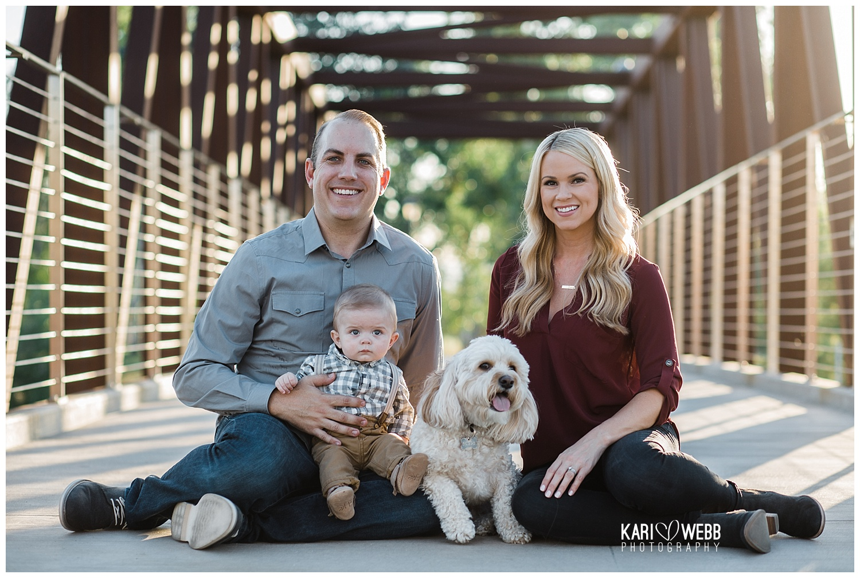 Kari Webb Photography_Irvine Family Photographer_ Family of three sitting on bridge.jpg