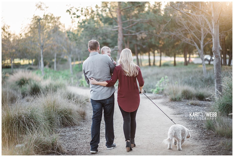 Kari Webb Photography_Irvine Family Photographer_ Family of three walking along path.jpg