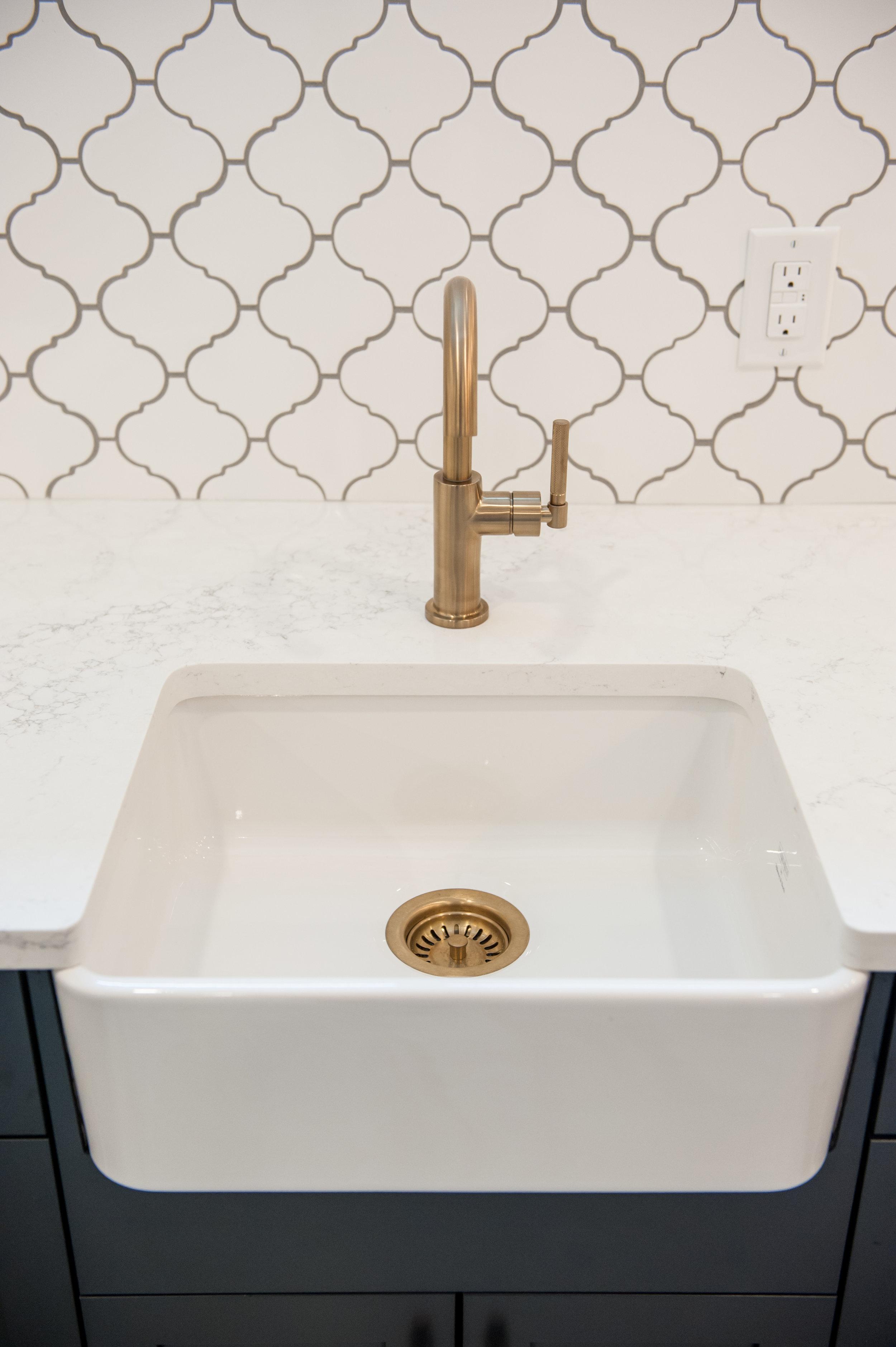 gold faucet white backsplash
