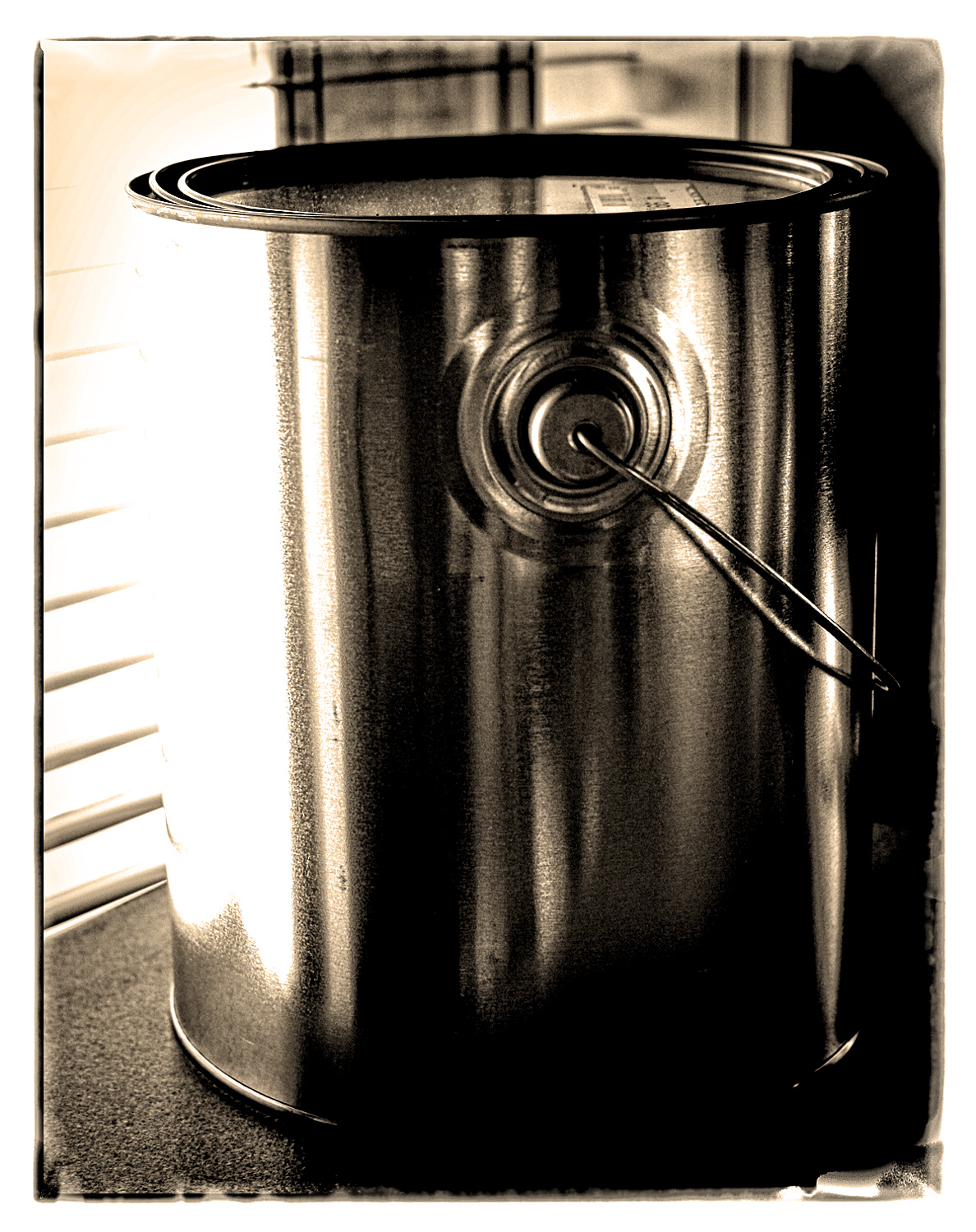 A paint can sitting by the window in my studio.