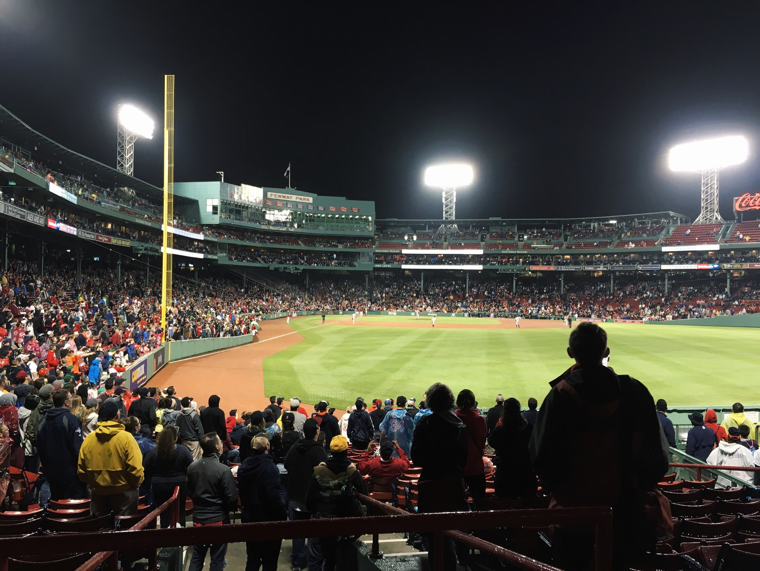 The final pitch of the game went to Big Papi, and everyone crowded around the field.