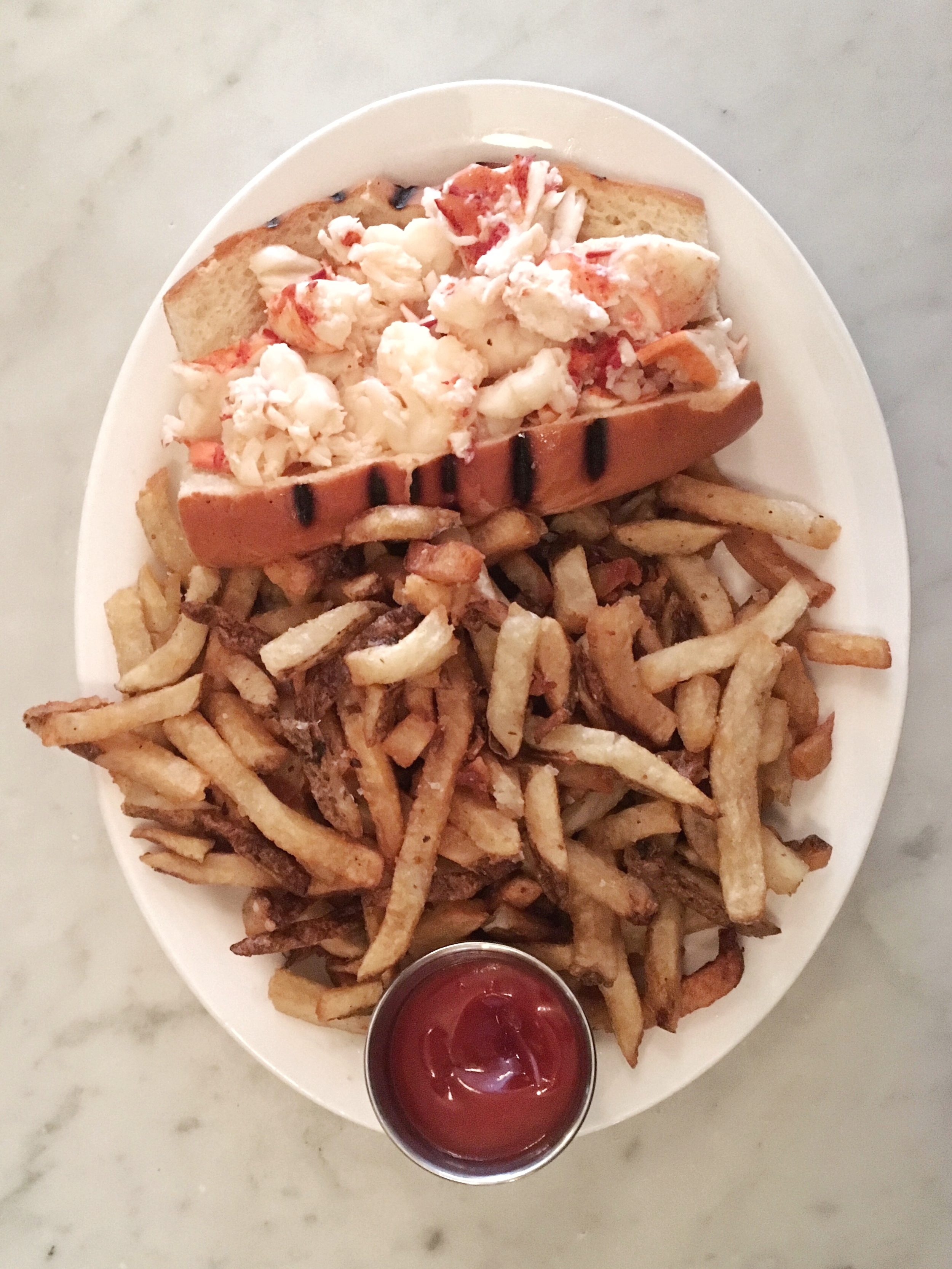 Hot lobster roll with butter and enough fries to feed the whole North End. It lived up to the hype, but we need to go back to try it cold with mayo, for science's sake.