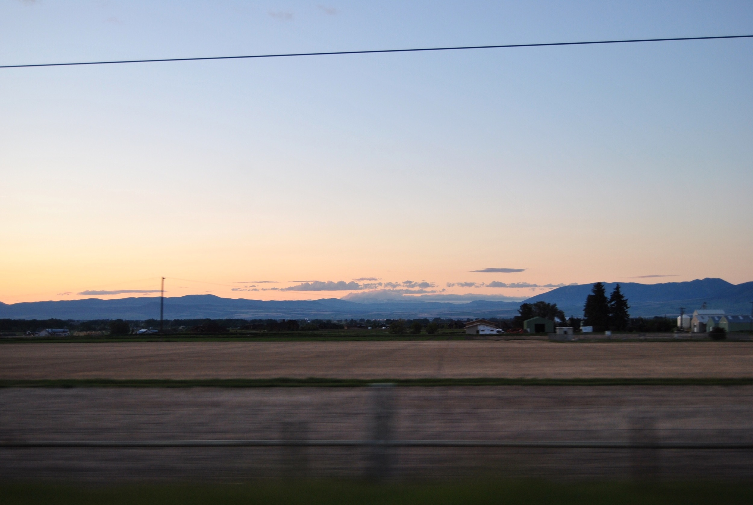 The distant sunset (there's so little to obscure the sun in Montana that the sun set reeeaaaally far away) and blue mountains as we passed through Bozeman looked like a painted backdrop. Some people get to watch this sunset every night. How does anybody get any work done around here?