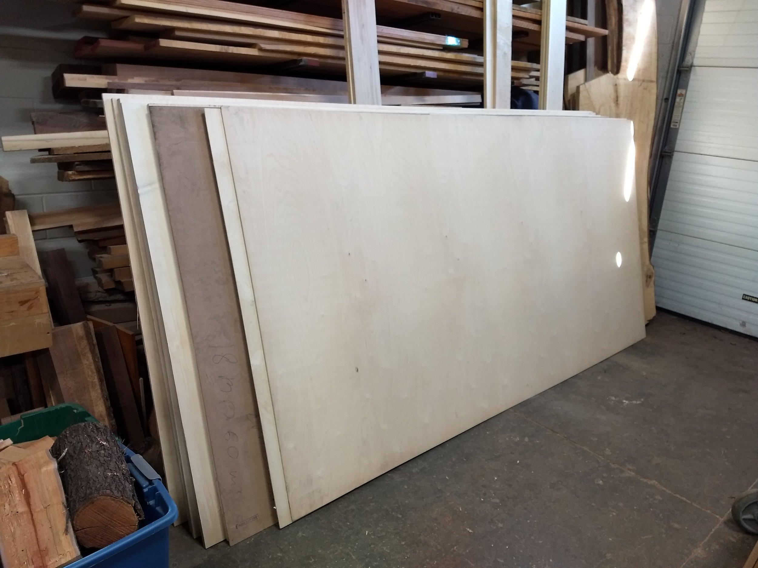 Stack of plywood for ceiling, walls, and cabinets