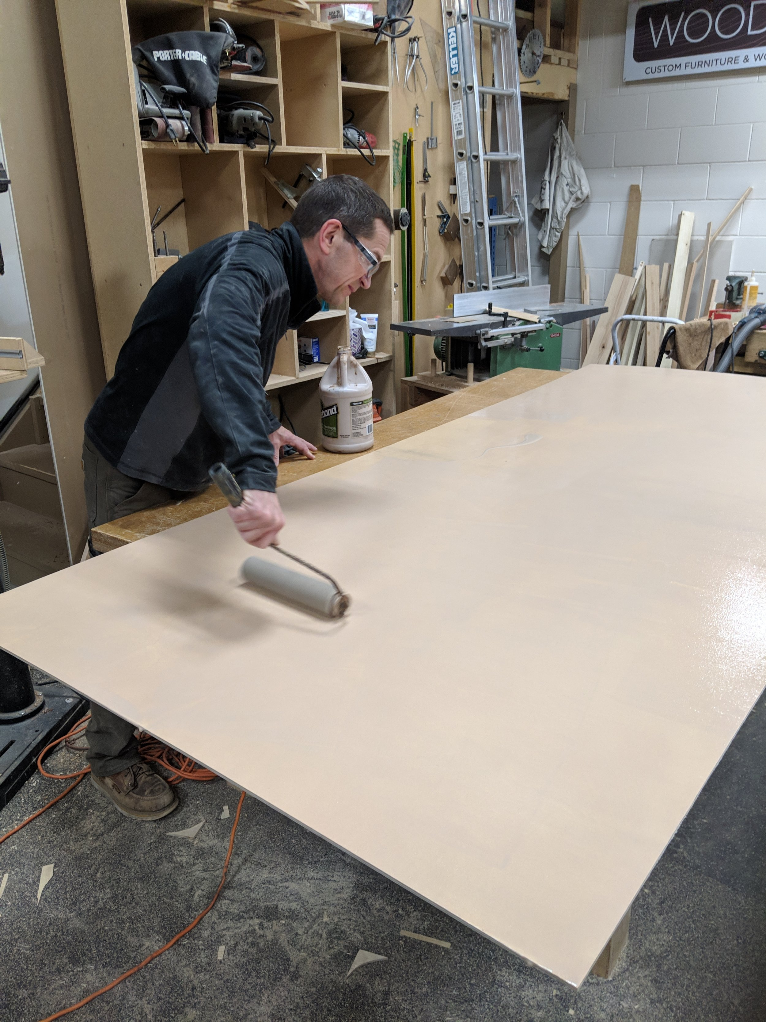 Rolling on glue for passenger wall panel