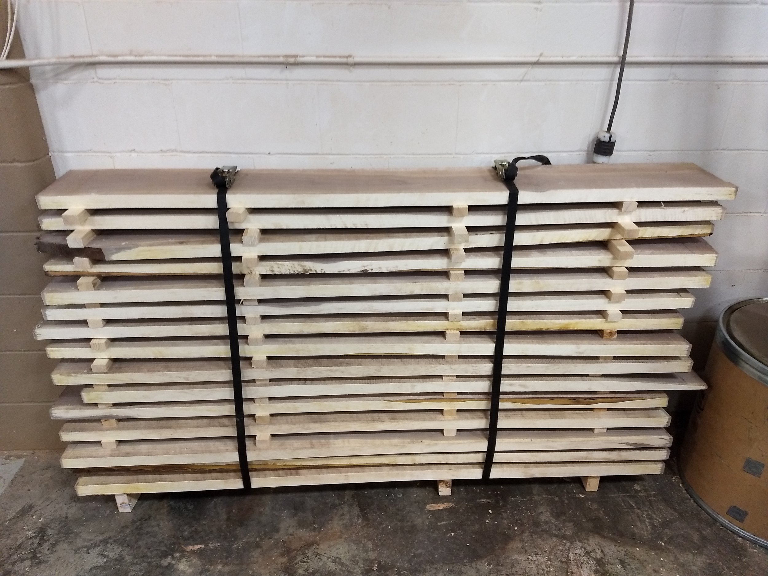 Cut boards stacked to dry