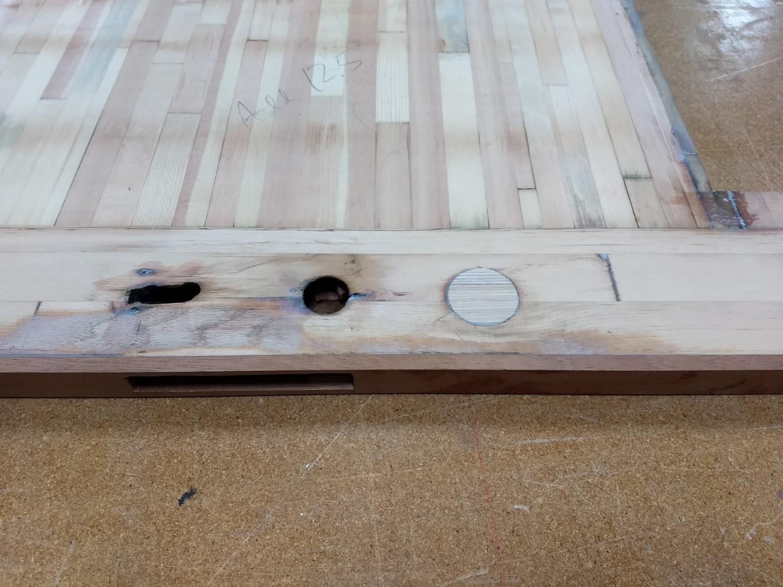 Plugged deadbolt hole