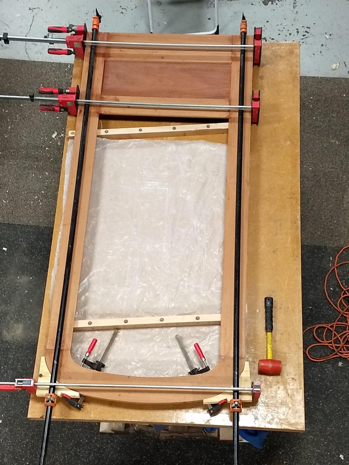 Assembled door in clamps