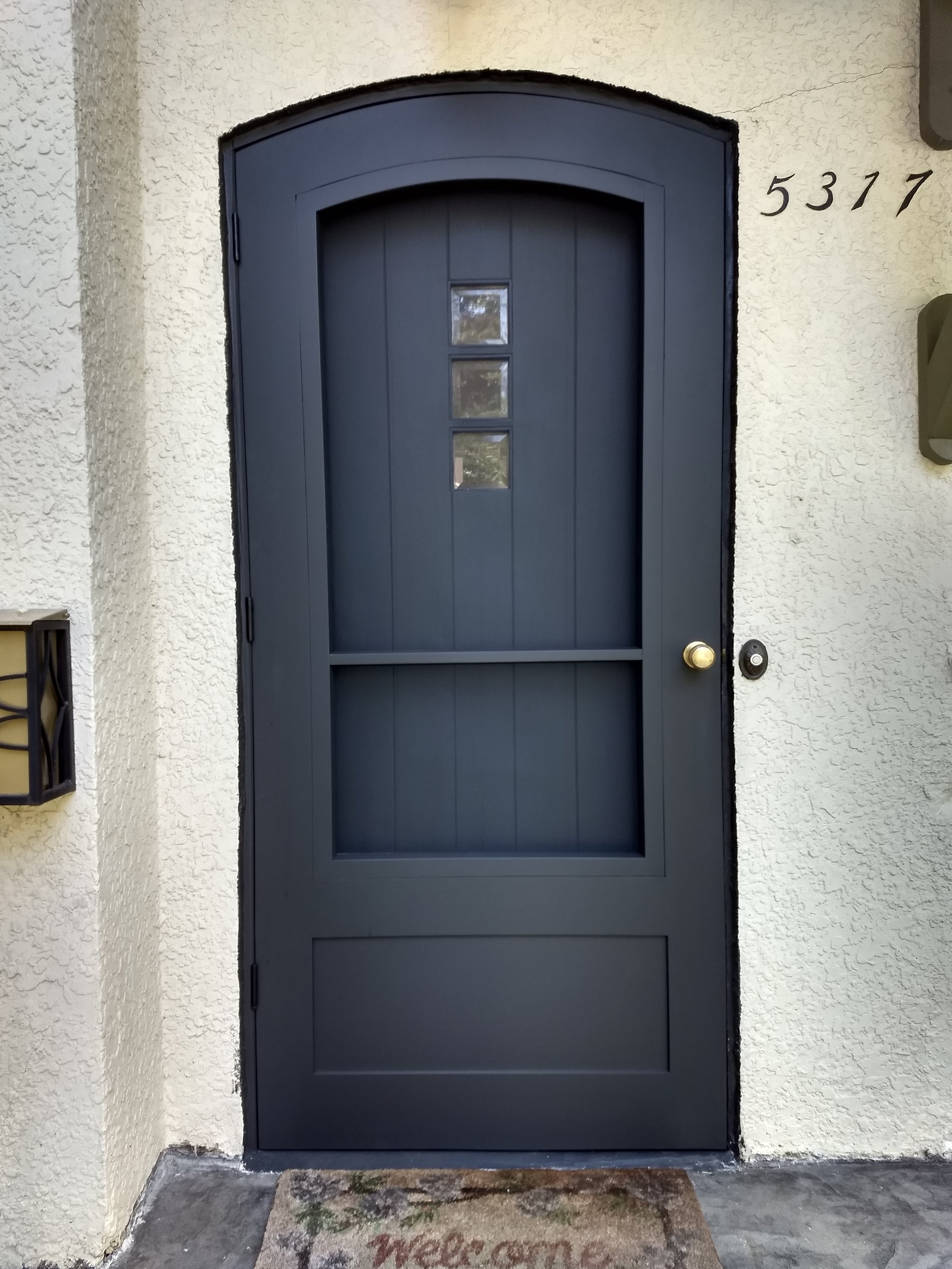 After - New door with arched screen & glass