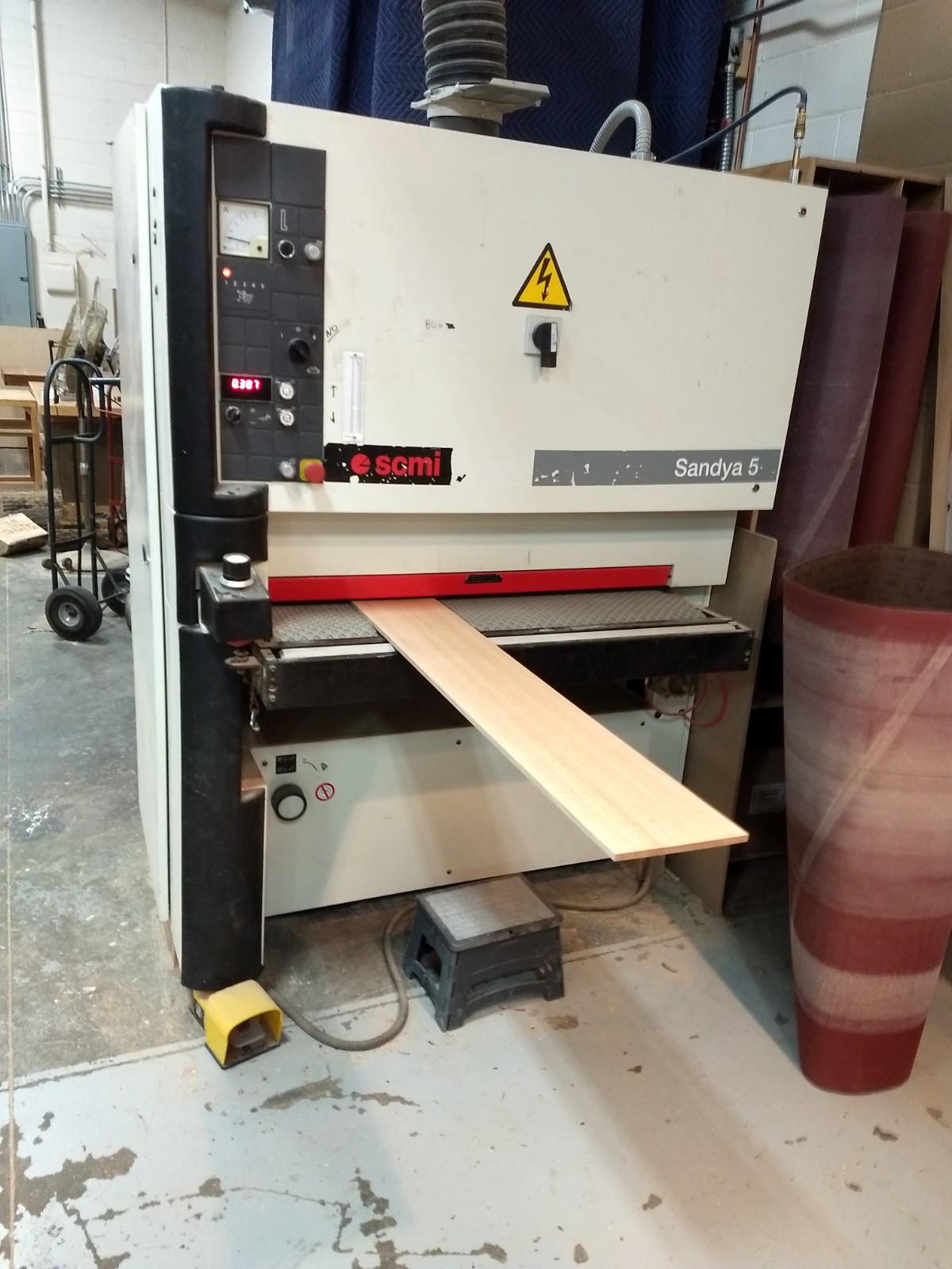 Sanding plies on widebelt sander