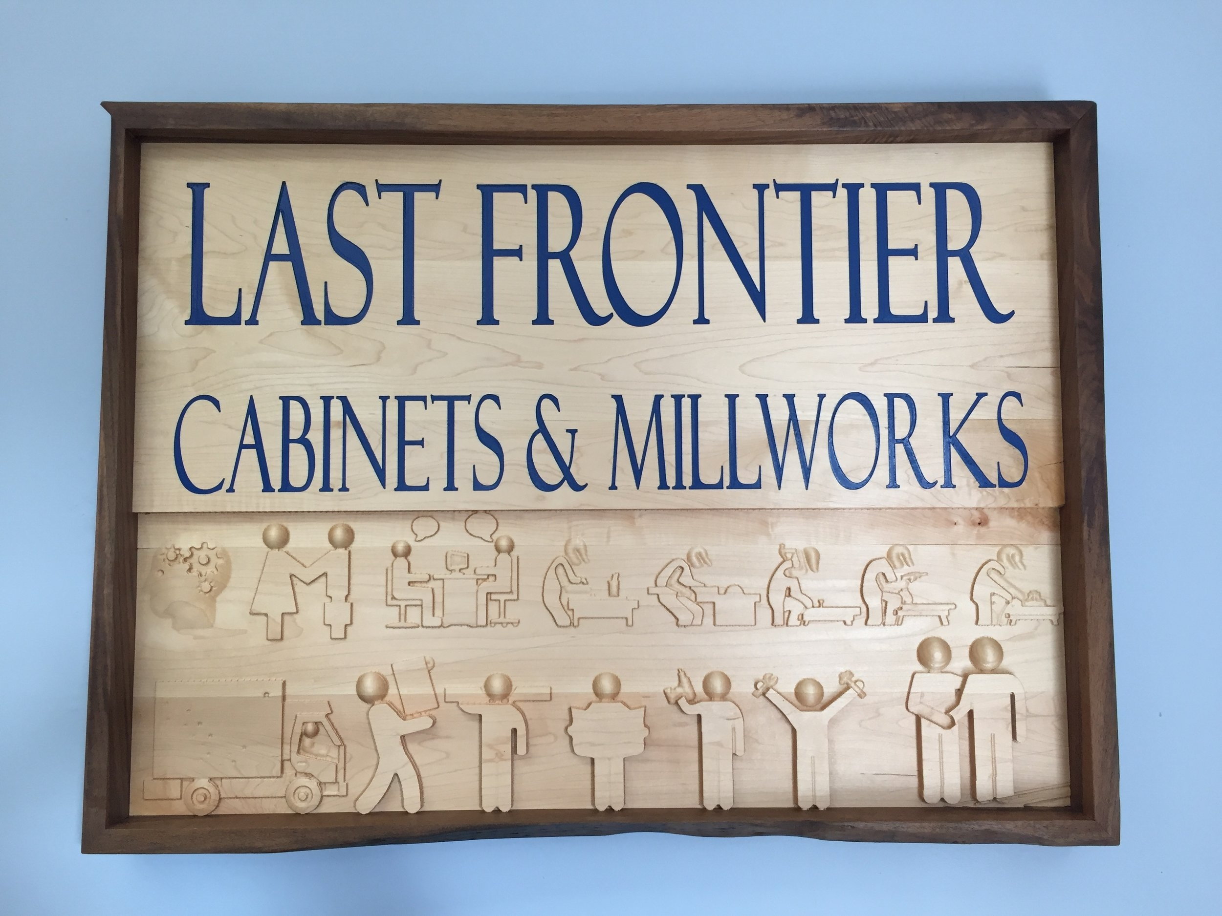 - Fun sign in our office made in maple with a live edge walnut frame.