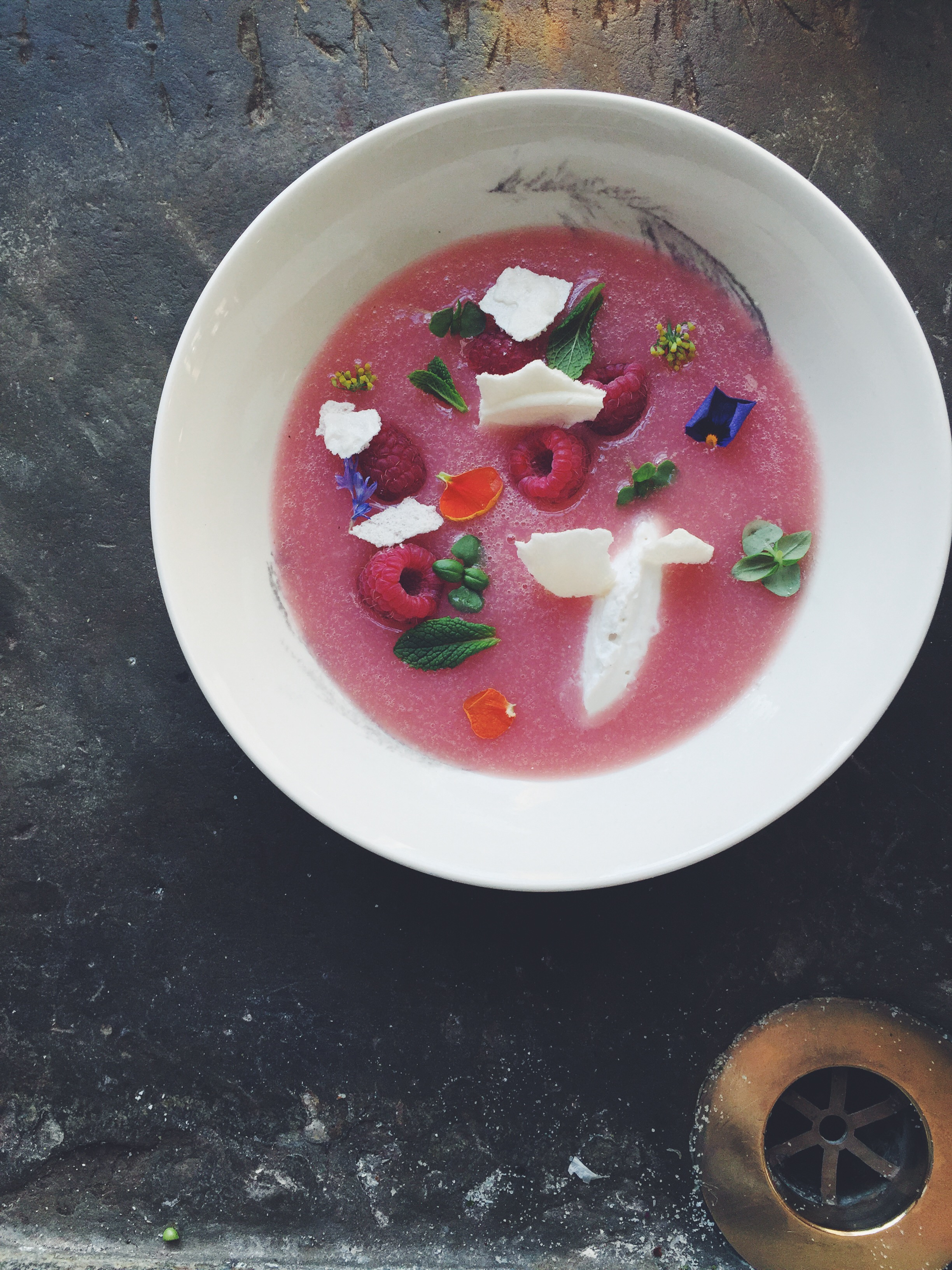 HillFoodCo_Peach and apricot liquor soup, vanilla coconut cream, Meringue, basil, raspberries and herbs.jpg