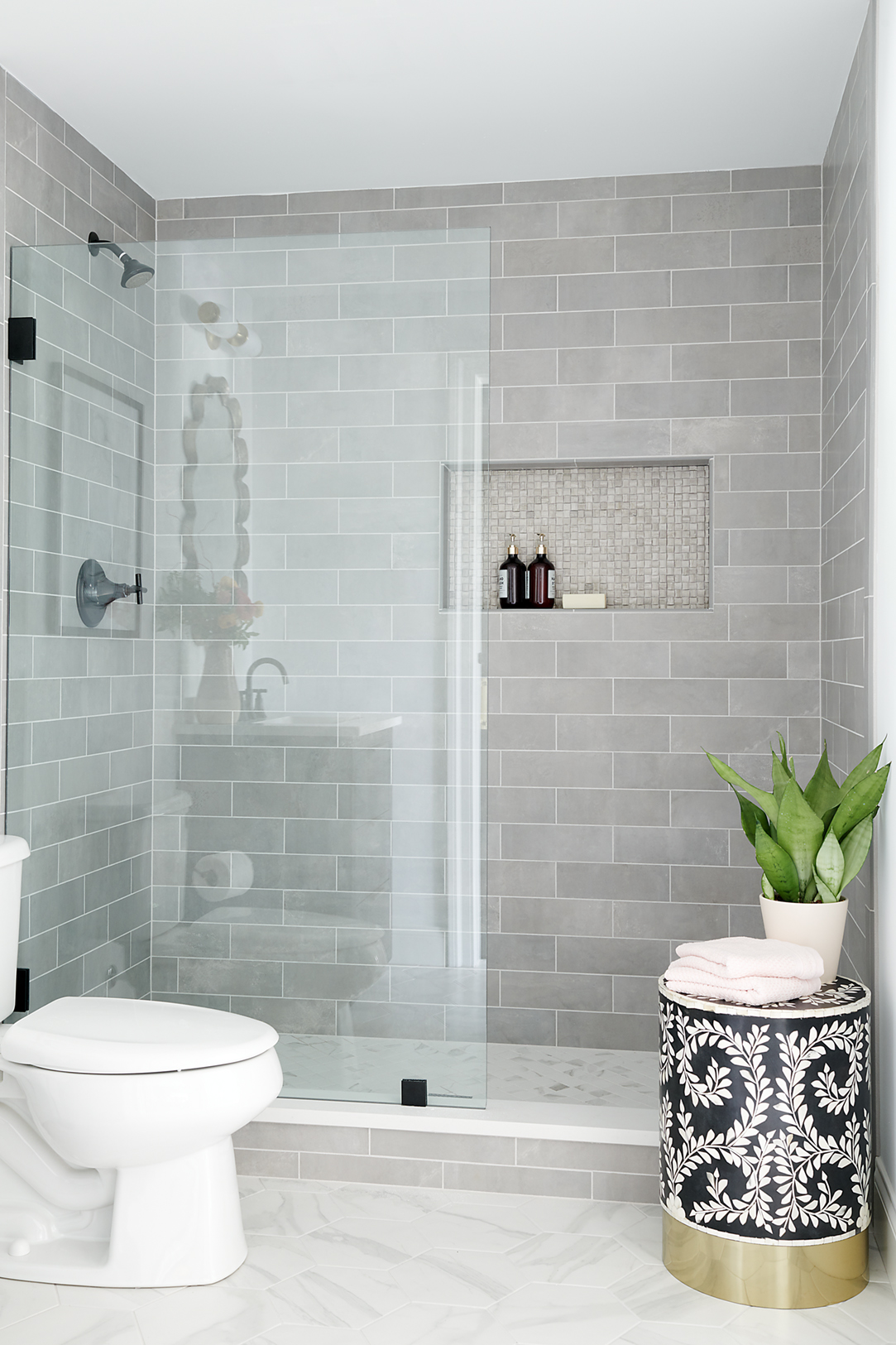 A soft tile palette gives this space a soothing feel.