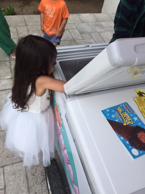 Kids choosing their choice of ice cream from one of our ice cream carts. Doing our part to help create special ice cream occasions