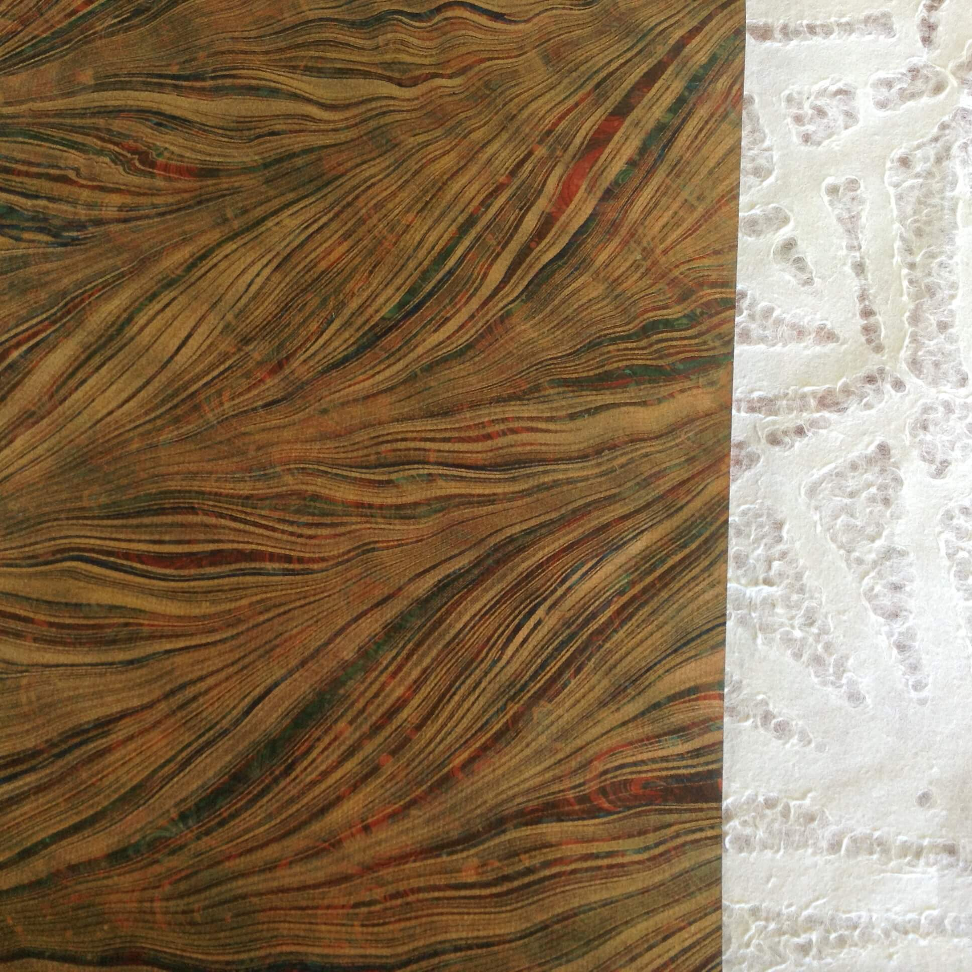 Contrasting papers, including a sheet of French double-marbled paper.
