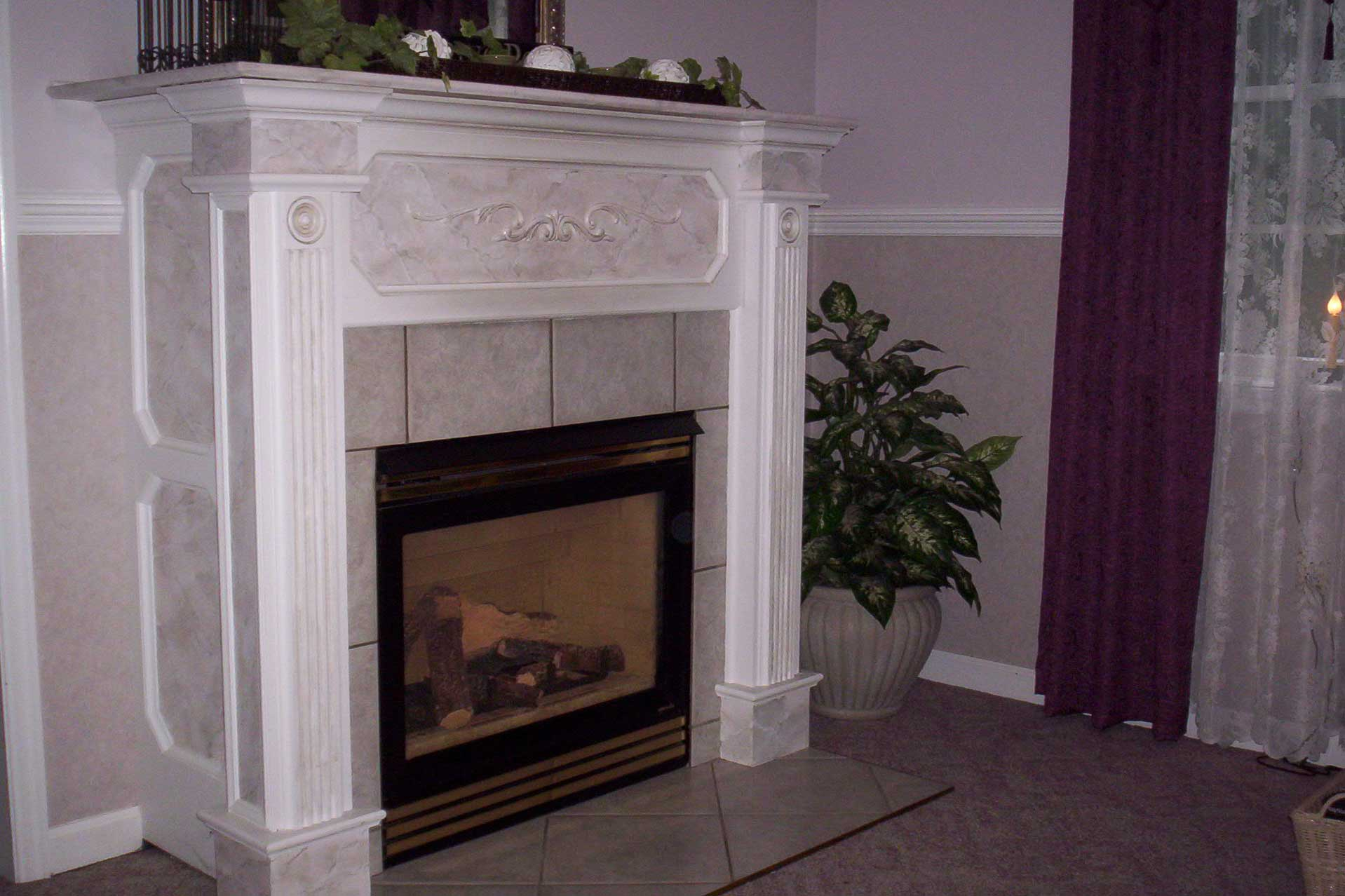 Custom Built Mantle Around Direct Vent Fireplace