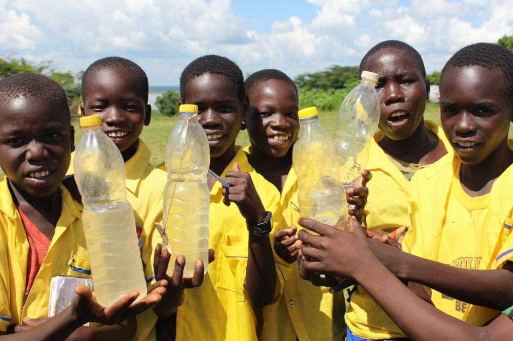 School boys drinking clean water