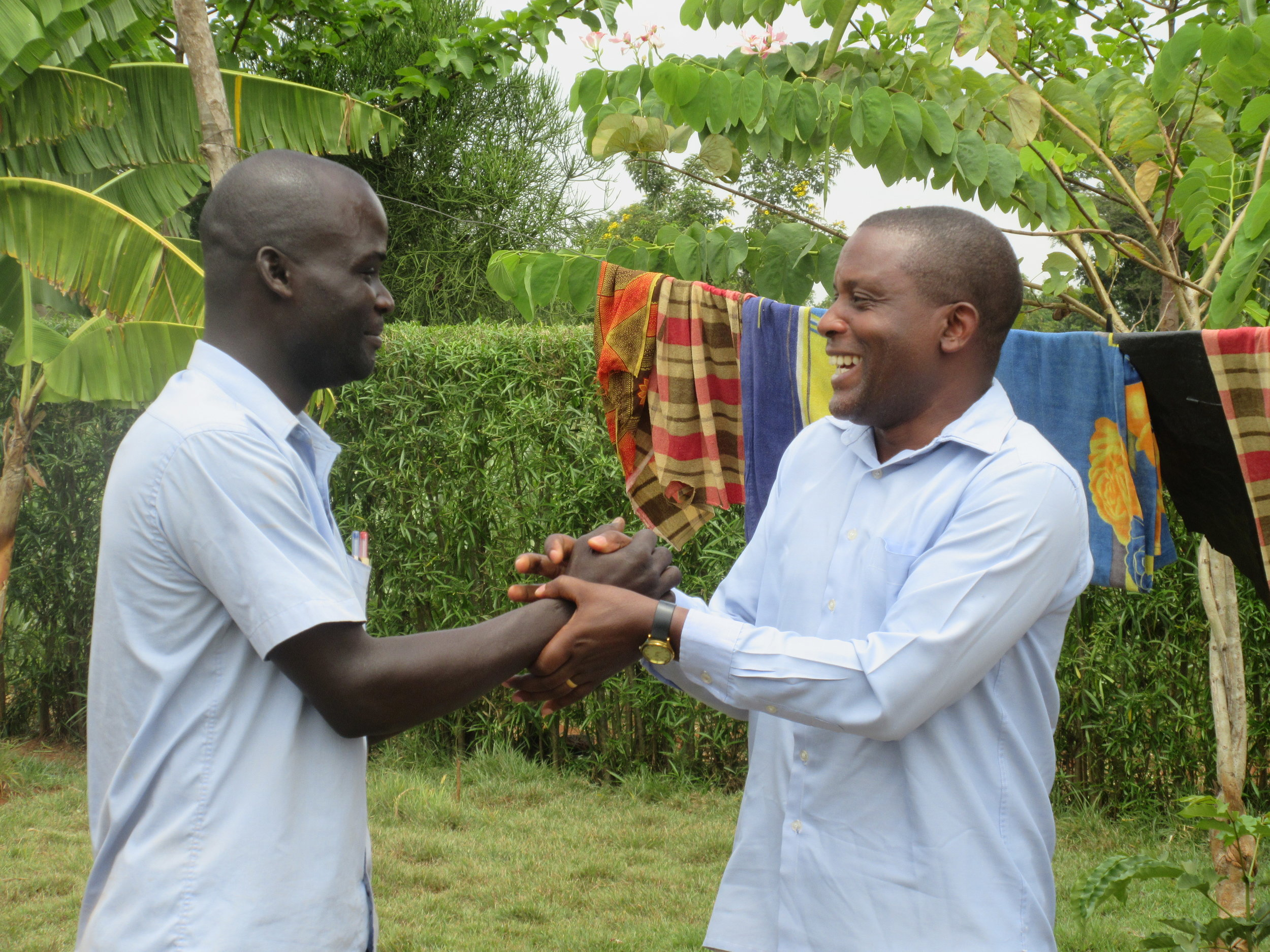 Shaking hands with Joseph Tumushime