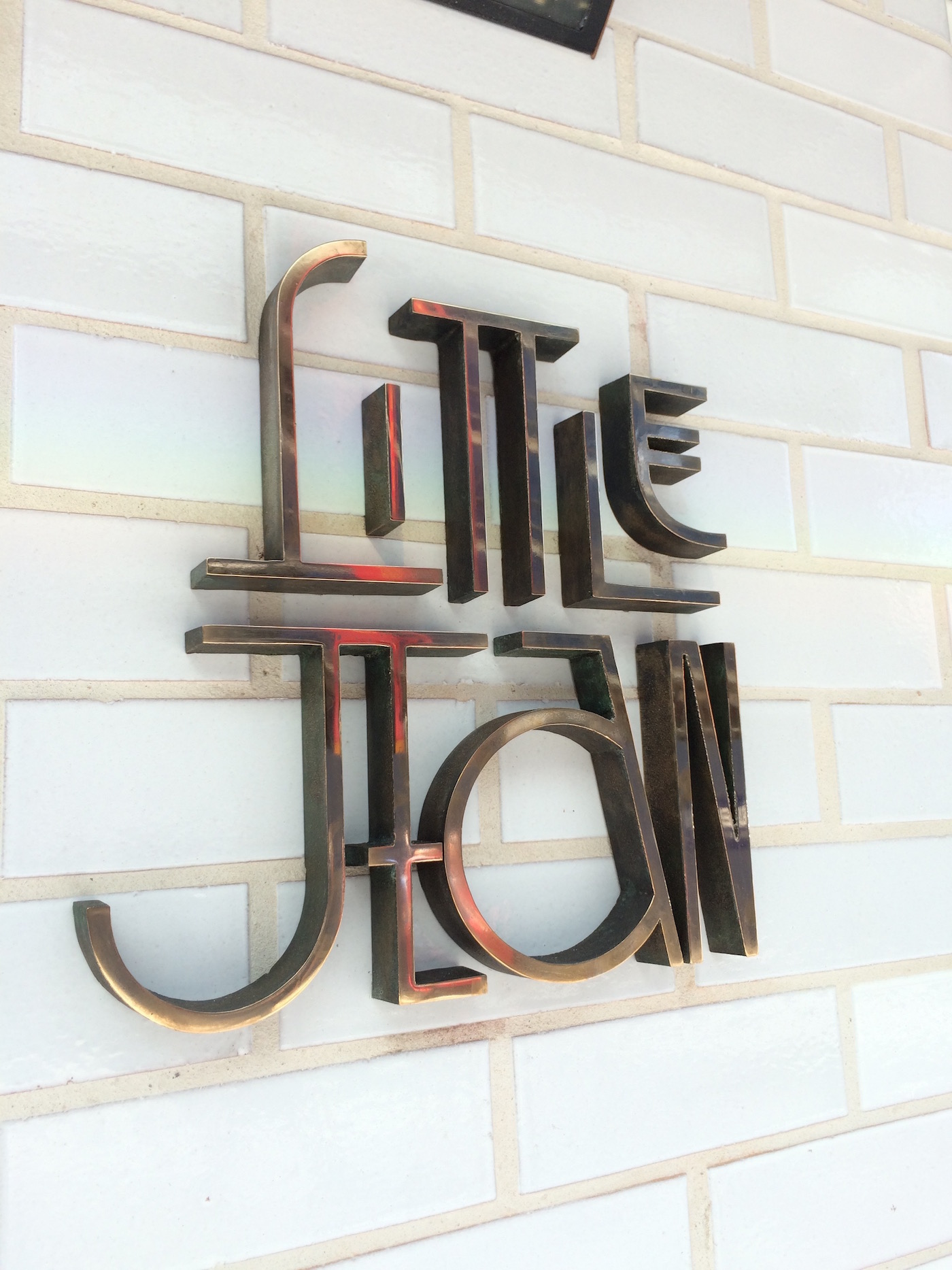 Little Jean  Sign Sand cast brass with polished face.