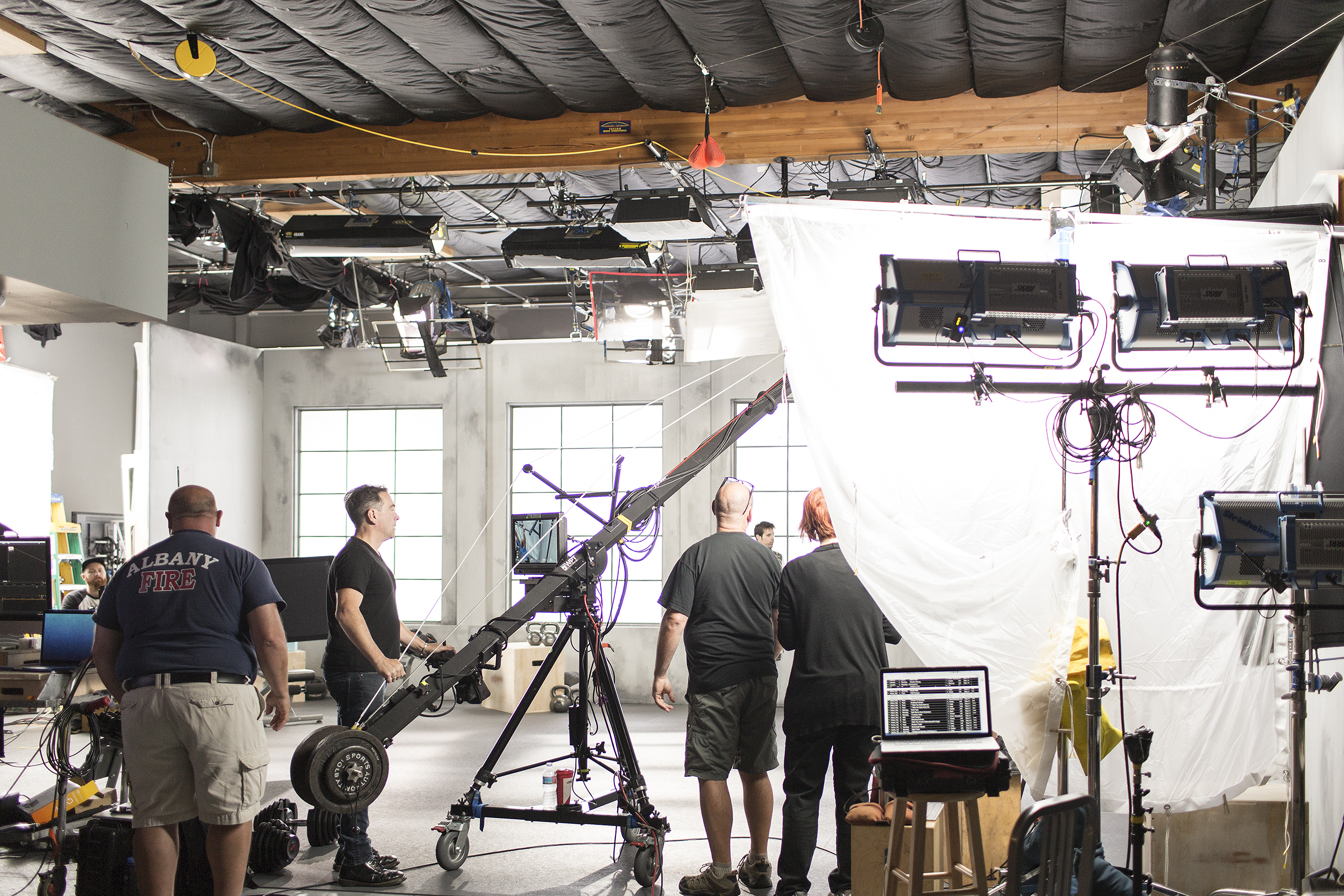 Behind the scenes on set at the Fitstar moves shoot. The production crew prepares for the first day of filming with the goal of capturing 600 exercise moves performed by over 17 models.