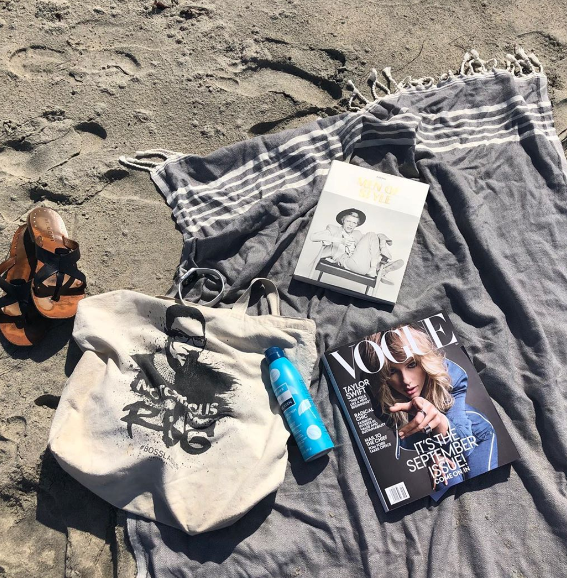 A Turkish towel, sunscreen, and reading material…