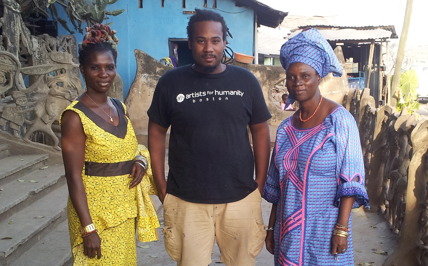 Stephen Hamilton with Oshun priestesses and sisters Ladunni and Adedoyin Olosun in front of Susanne Wenger's house in Osogbo.