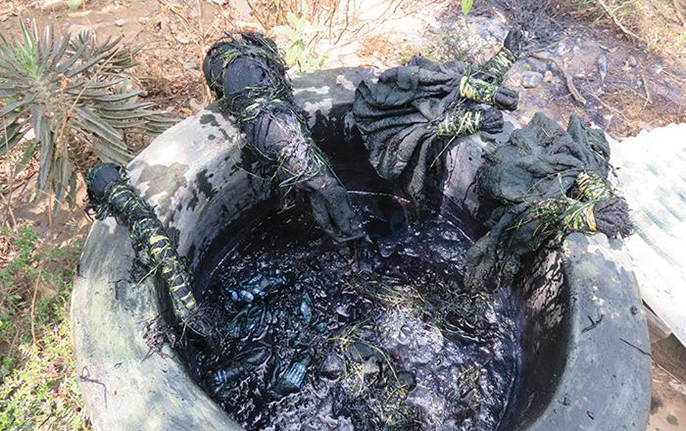 A view into an indigo dyeing pot with cloth in the works.©Stephen Hamilton