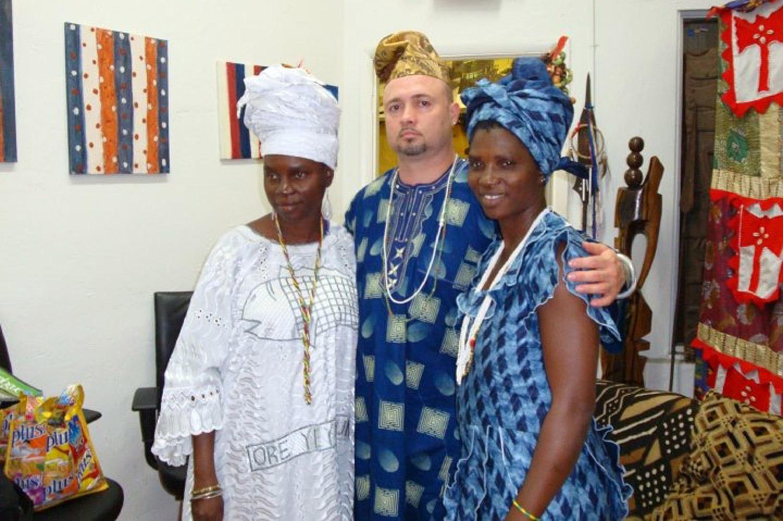 Nathan with Adedoyin Faniyi Olosun, daughter of Adunni Olorisa Susanne Wenger, and her sister Olayiwola Oladunni Olosun, both Oshun priestesses from the city of Oshogbo.©Nathan Lugo
