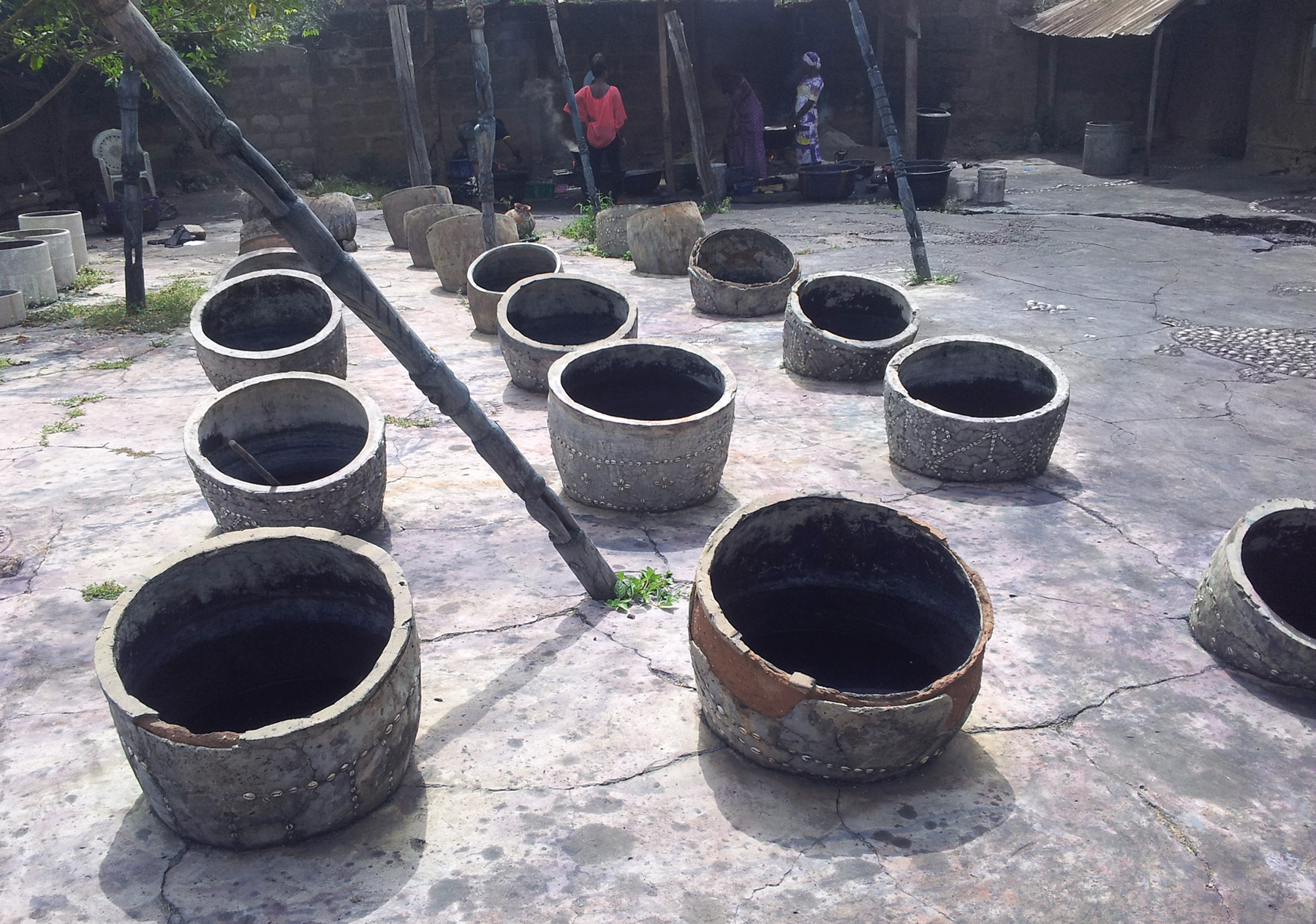 "Indigo, Yorùbá ""aro"", dyeing pots used by the ""aláro"", persons dyeing clothes in Yorùbáland. The leaves are fermenting inside the pots for days. ©orishaimage.com"