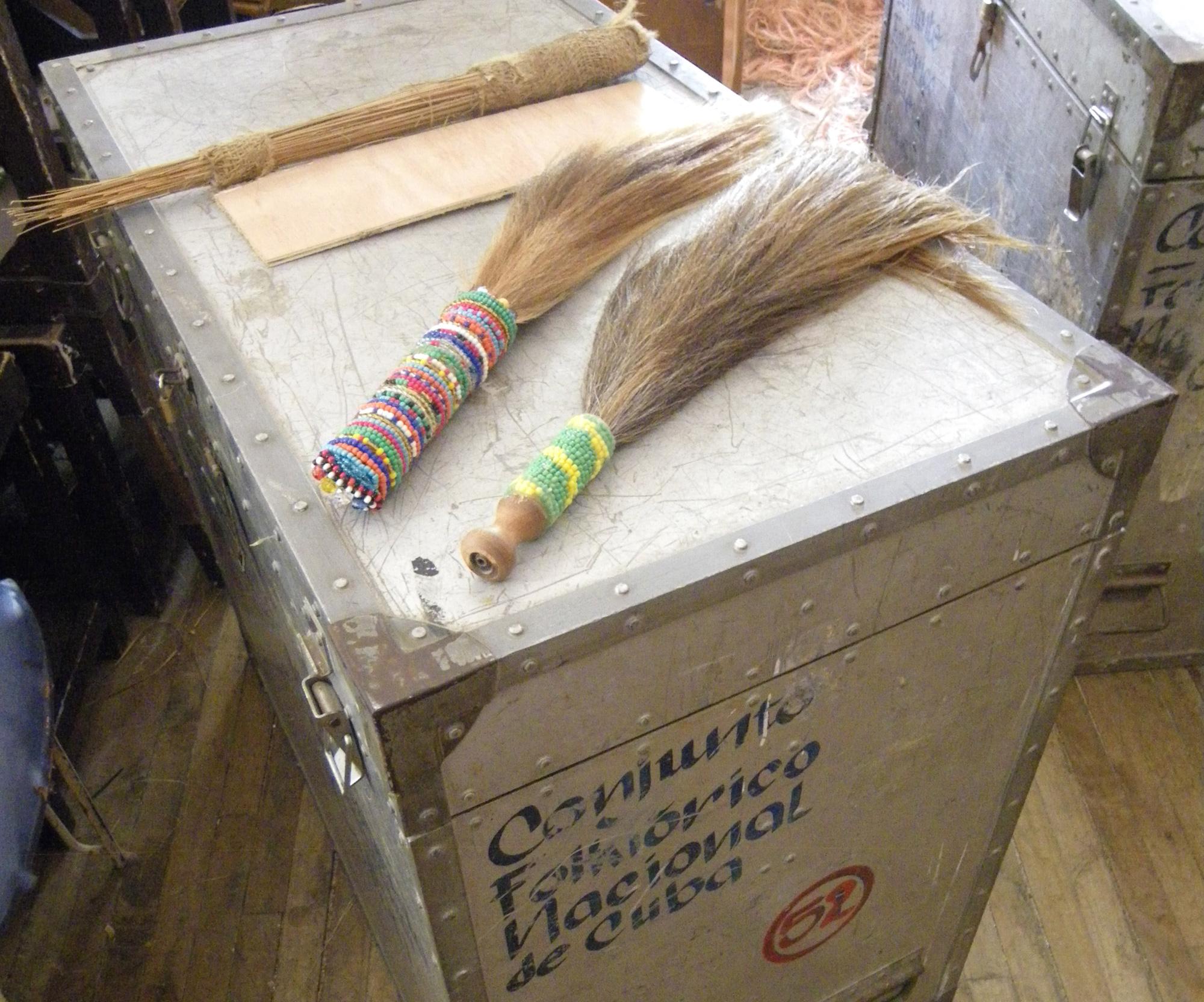 Babaluaye's broom and two iruke at the Conjunto Folklórico Nacional de Cuba in Havana. ©orishaimage.com