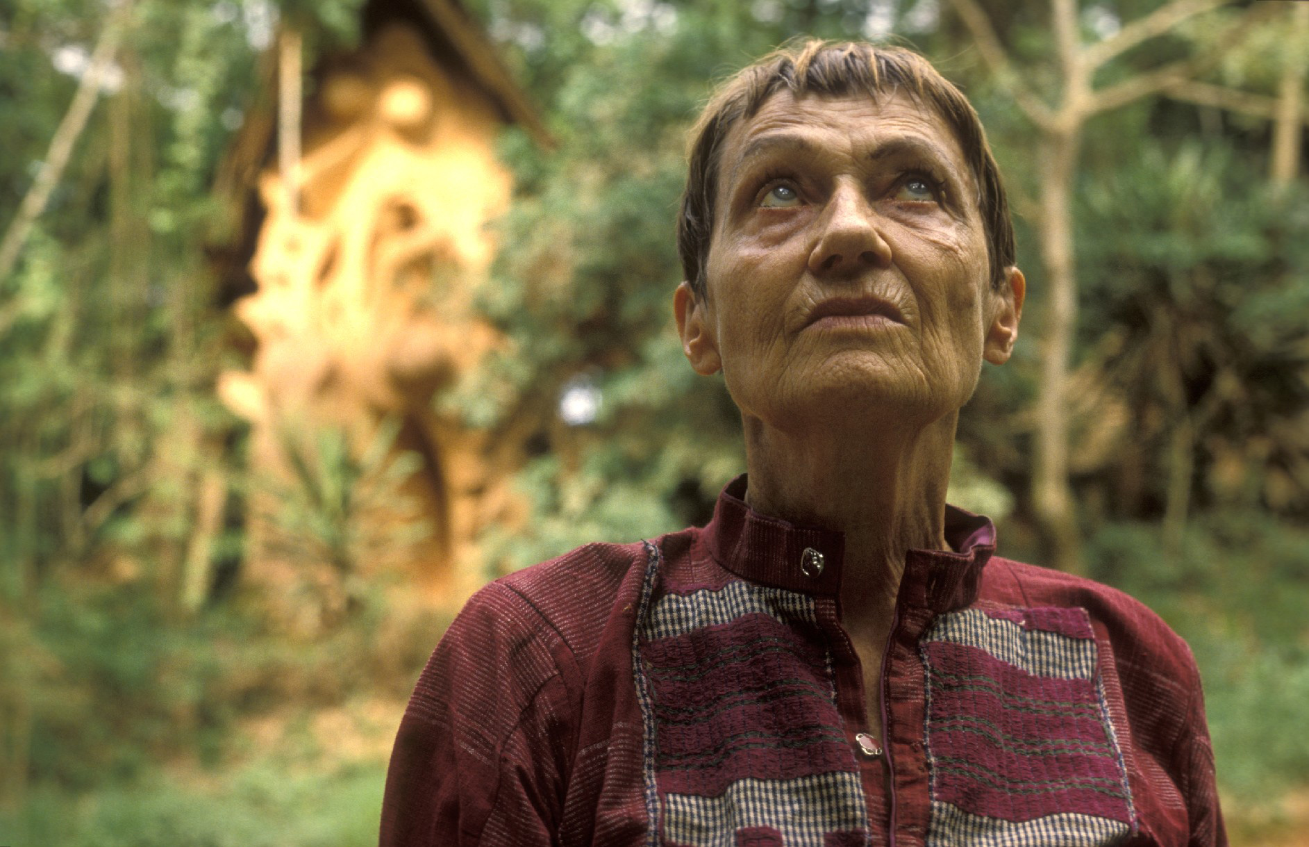 Susanne Wenger, with the Ọbàtálá shrine in the back at the Sacred Grove.©Wolfgang Denk